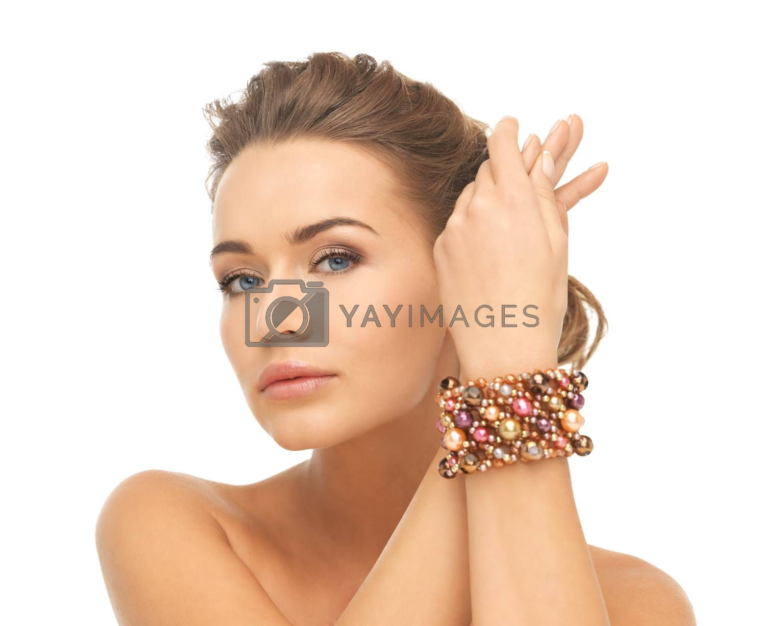 woman wearing bracelet with beads by dolgachov