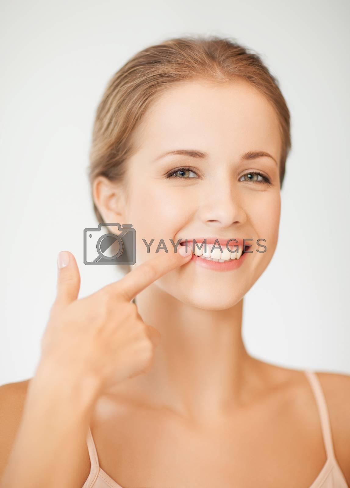 woman showing her teeth by dolgachov