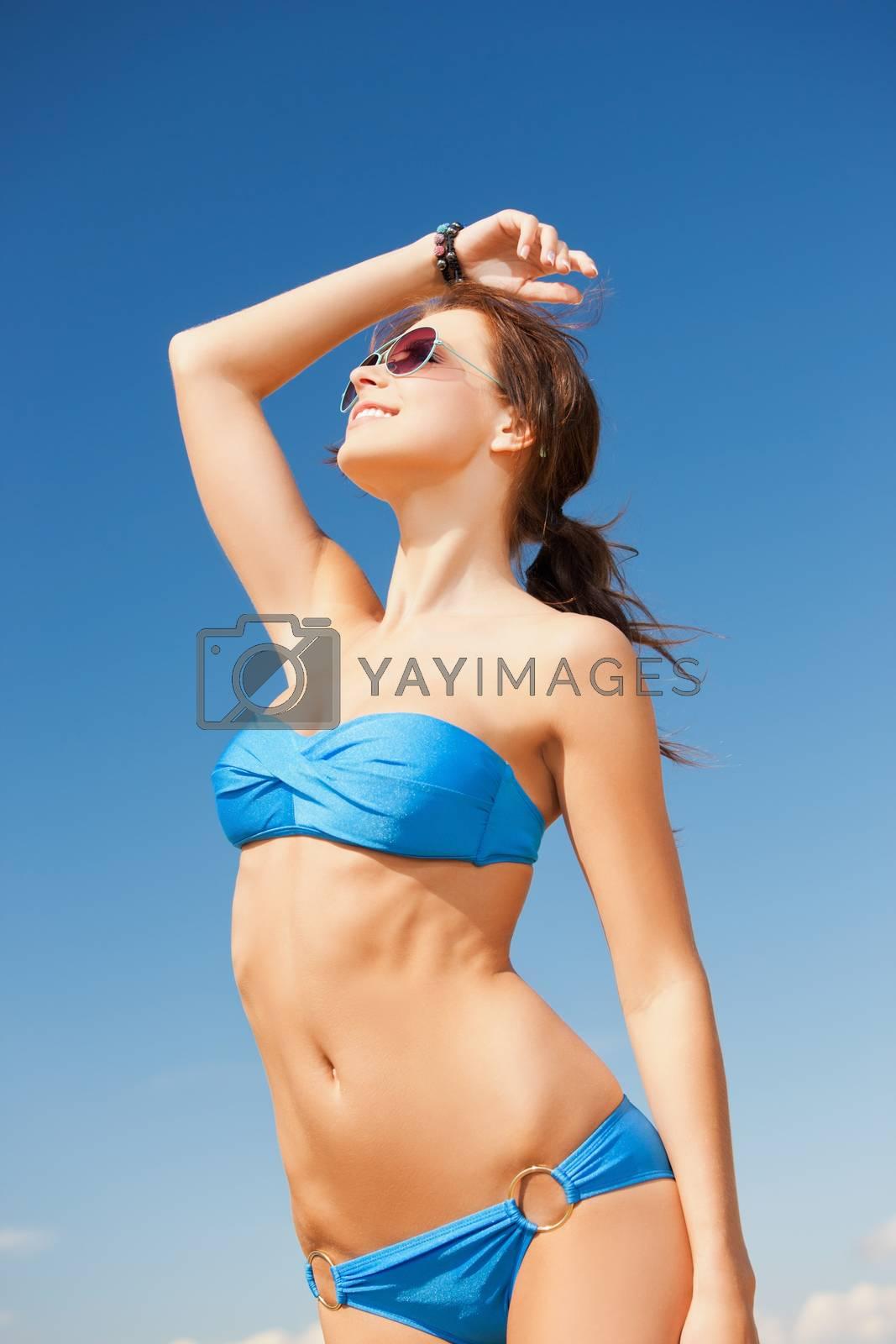 woman in bikini and sunglasses by dolgachov