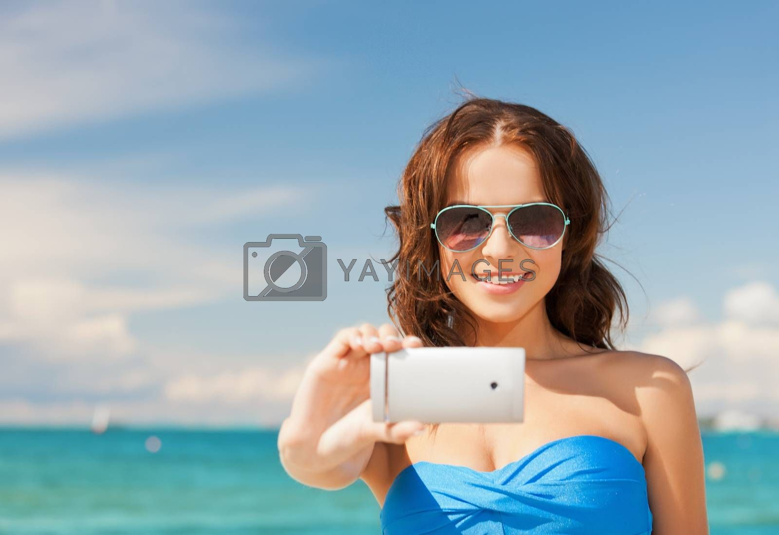 woman in bikini with phone by dolgachov