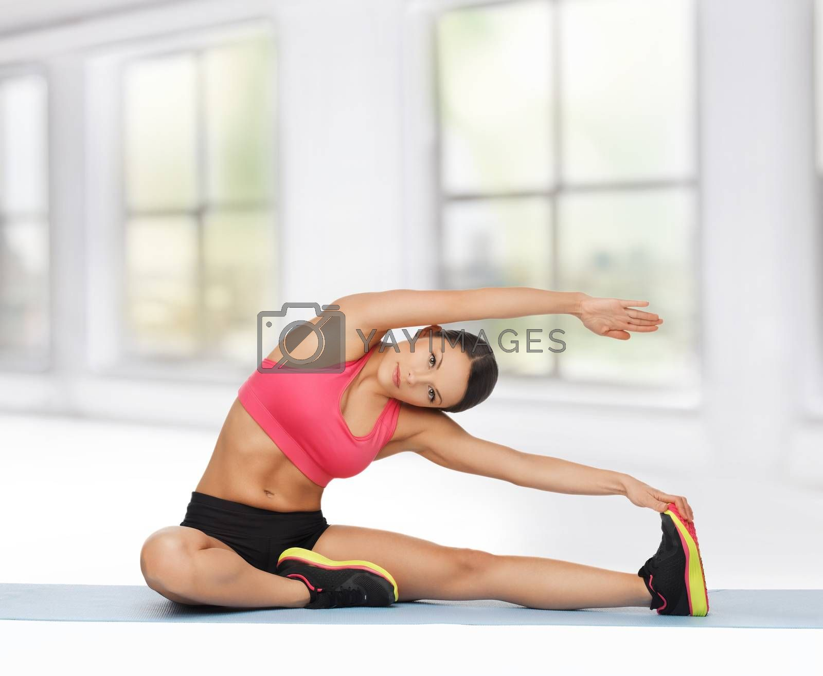 sporty woman doing exercise on the floor by dolgachov