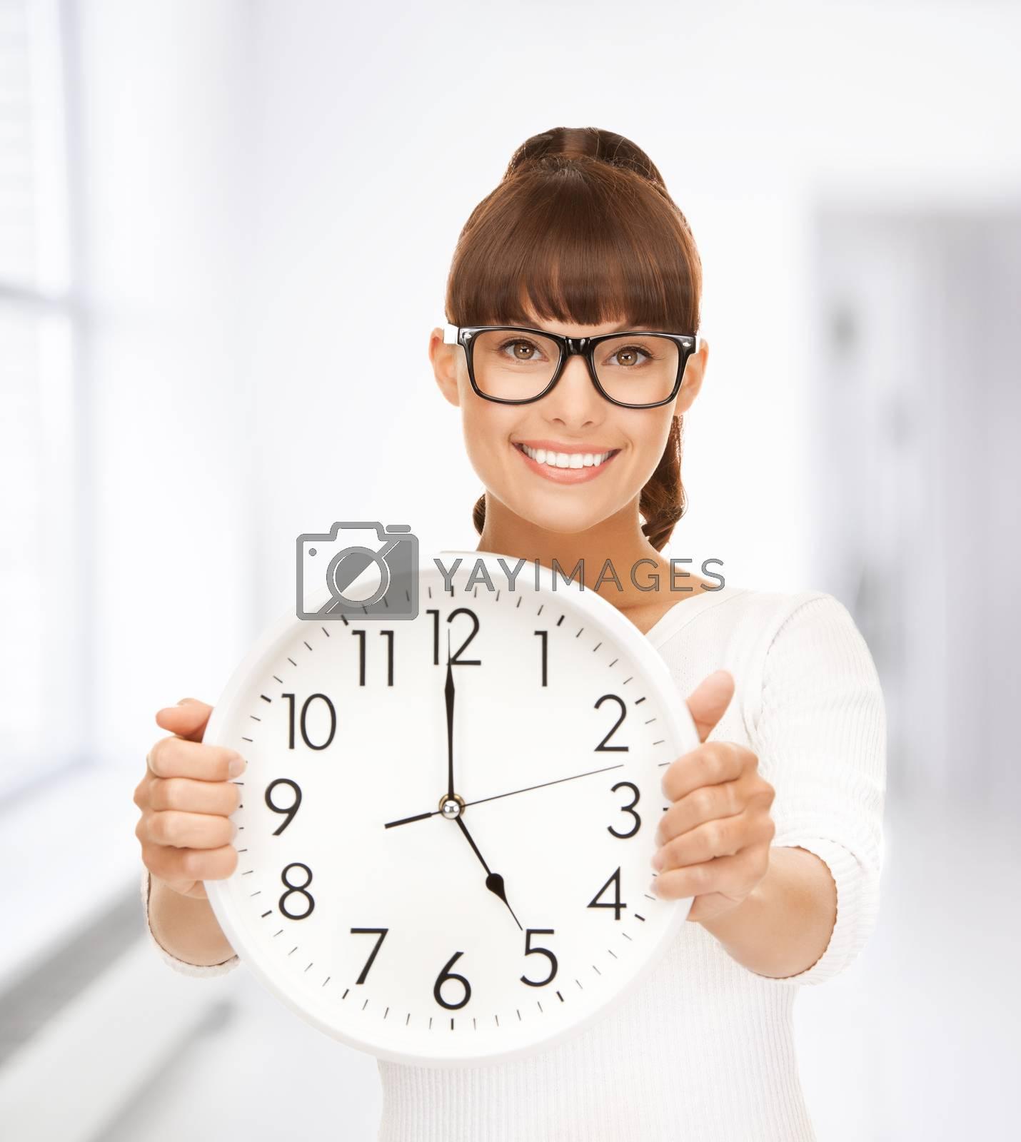 businesswoman with wall clock by dolgachov