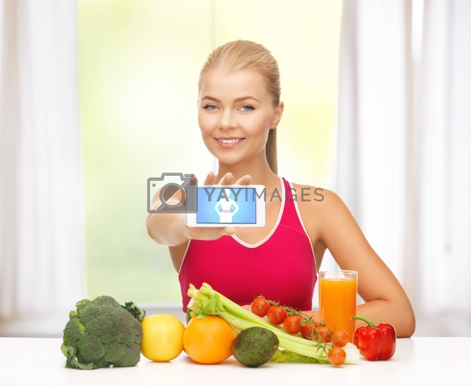 woman with fruits, vegetables and smartphone by dolgachov