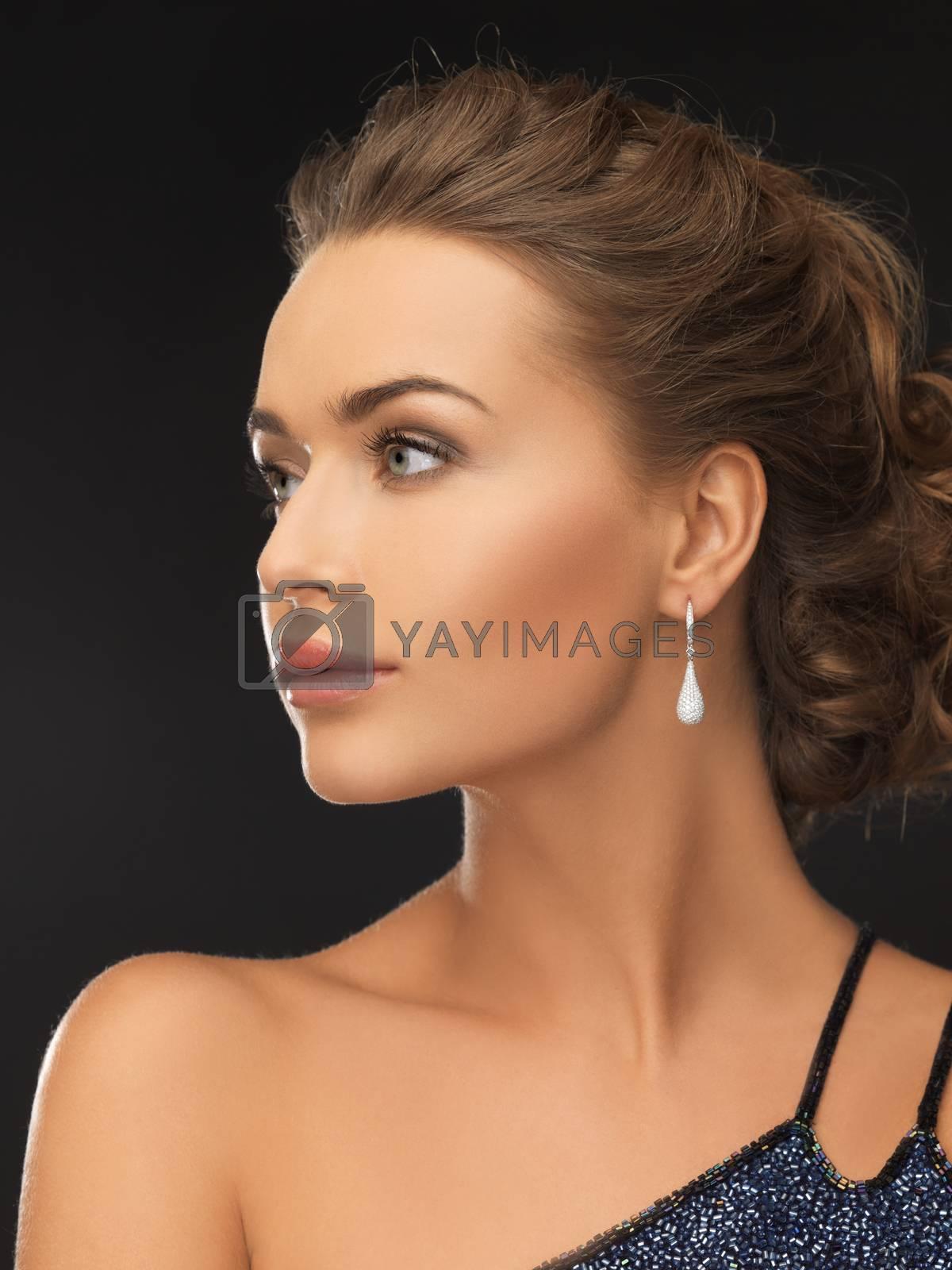 woman with diamond earrings by dolgachov