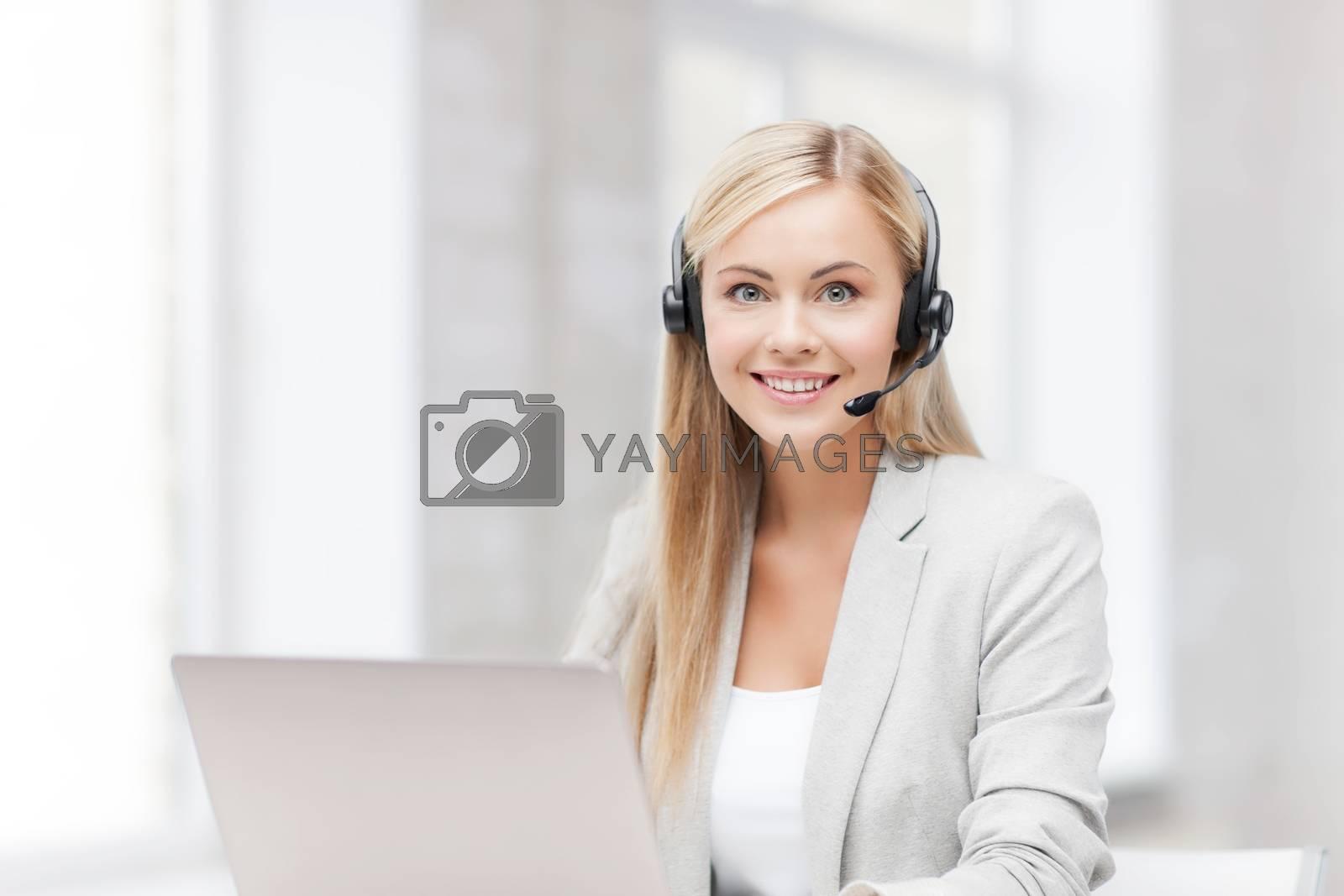 friendly female helpline operator with laptop by dolgachov