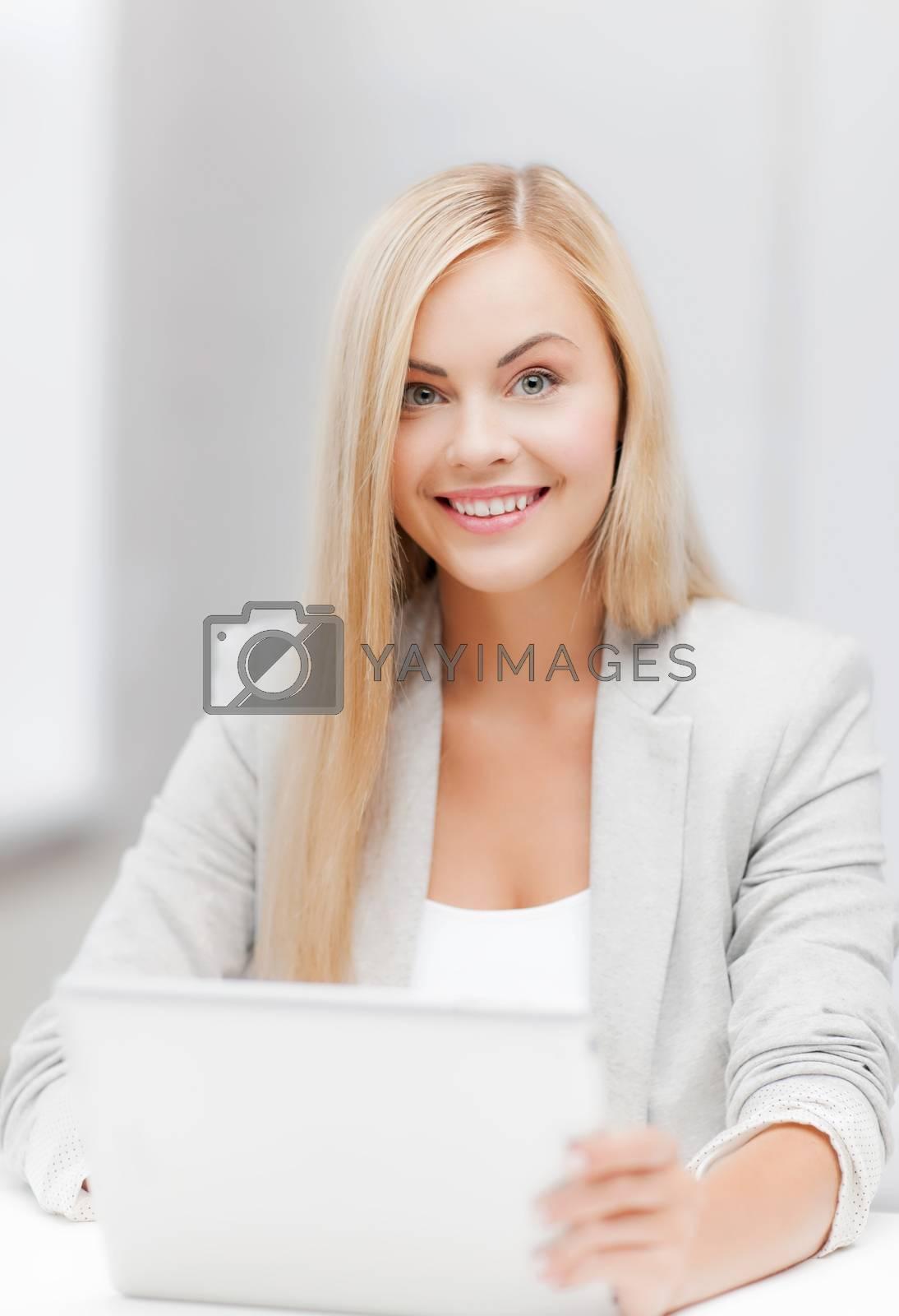 businesswoman with laptop by dolgachov
