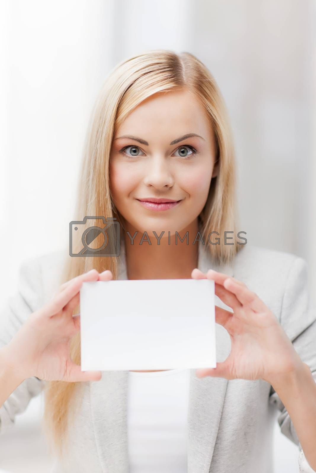 woman with blank business or name card by dolgachov