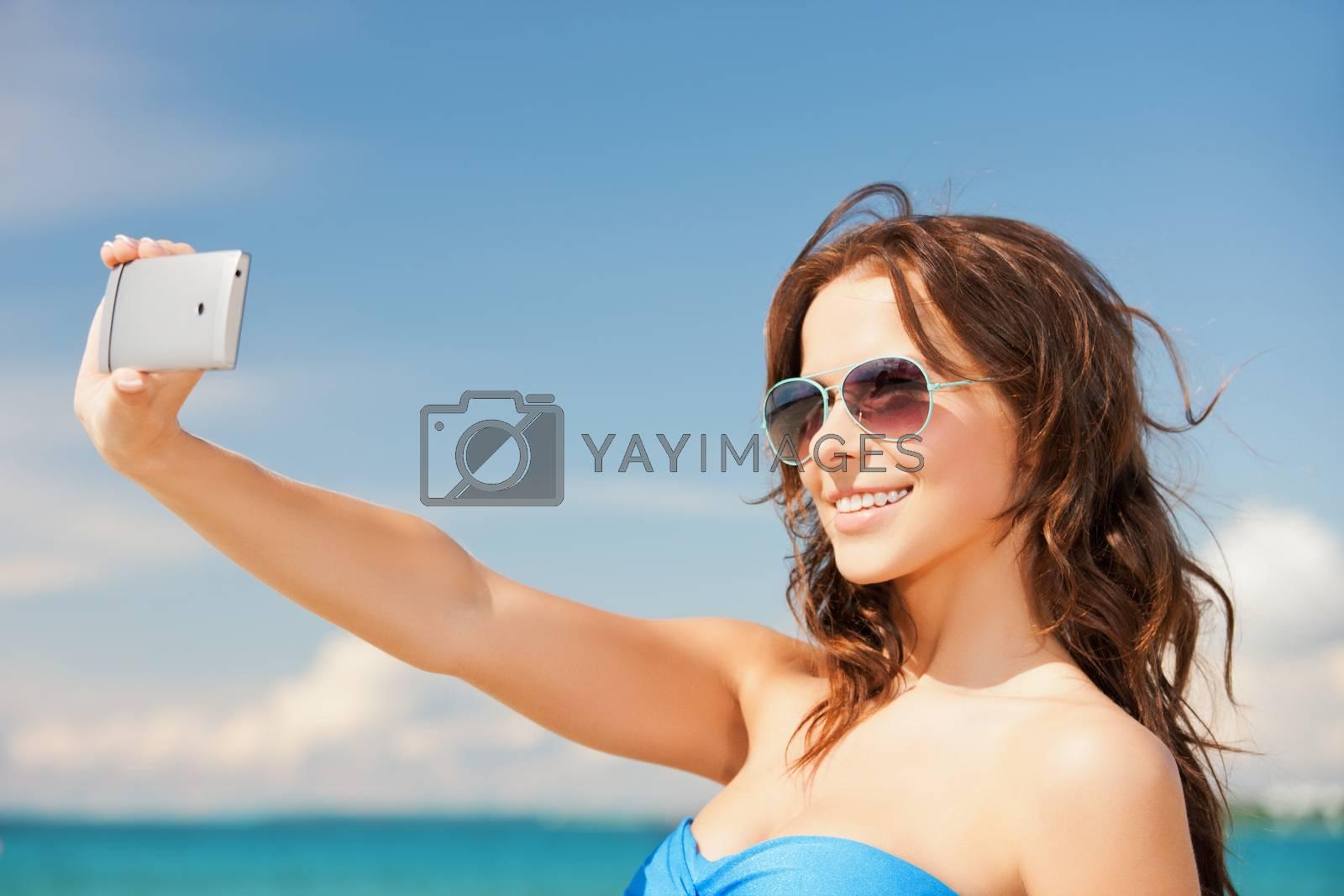 woman in bikini with phone by dolgachov