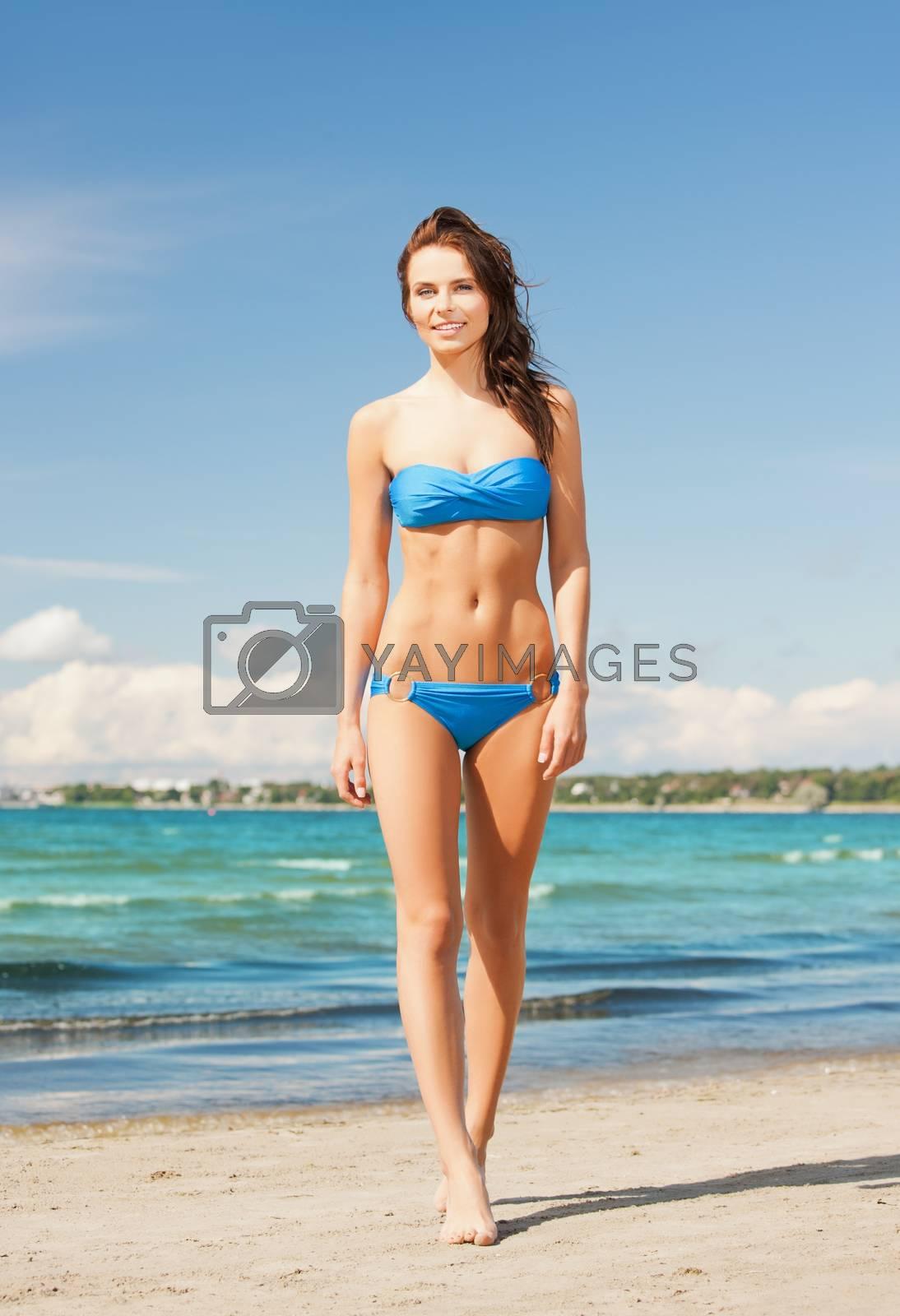 woman in bikini smiling by dolgachov