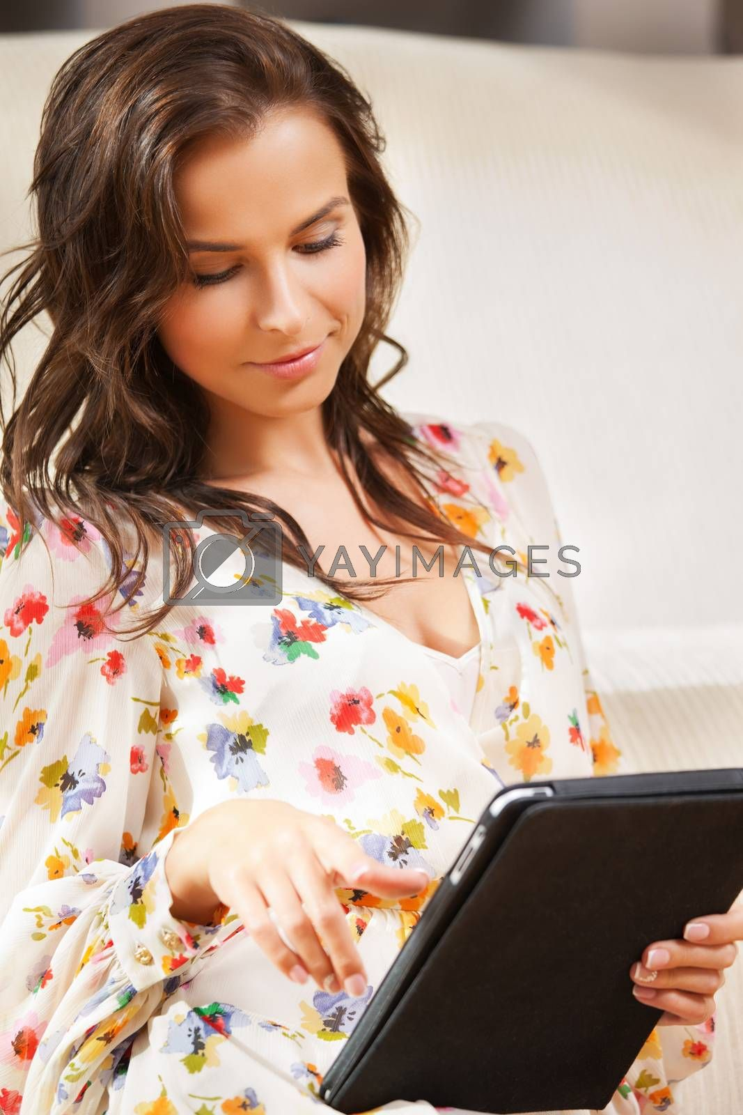 woman with tablet pc by dolgachov