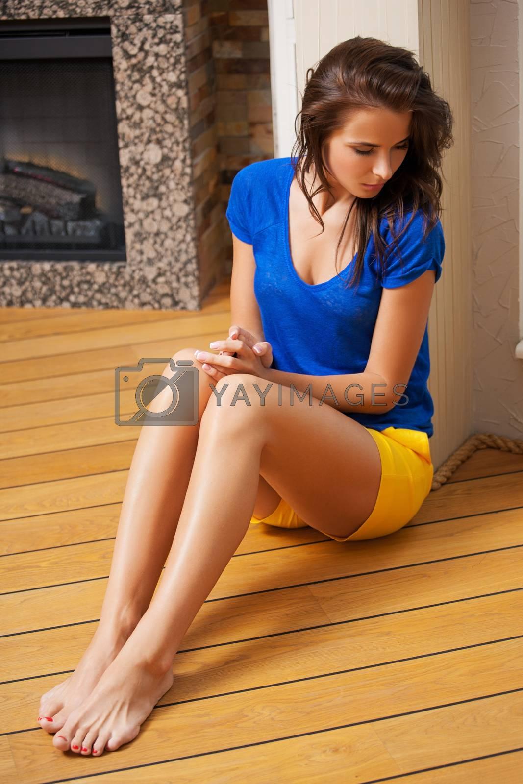 thinking woman sitting on the floor by dolgachov