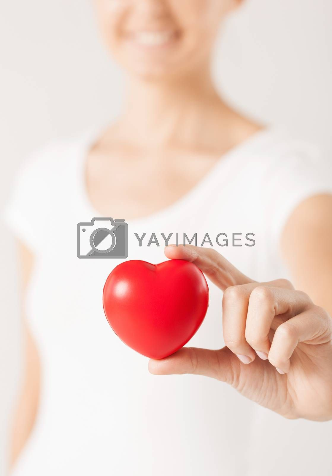 woman hands with heart by dolgachov