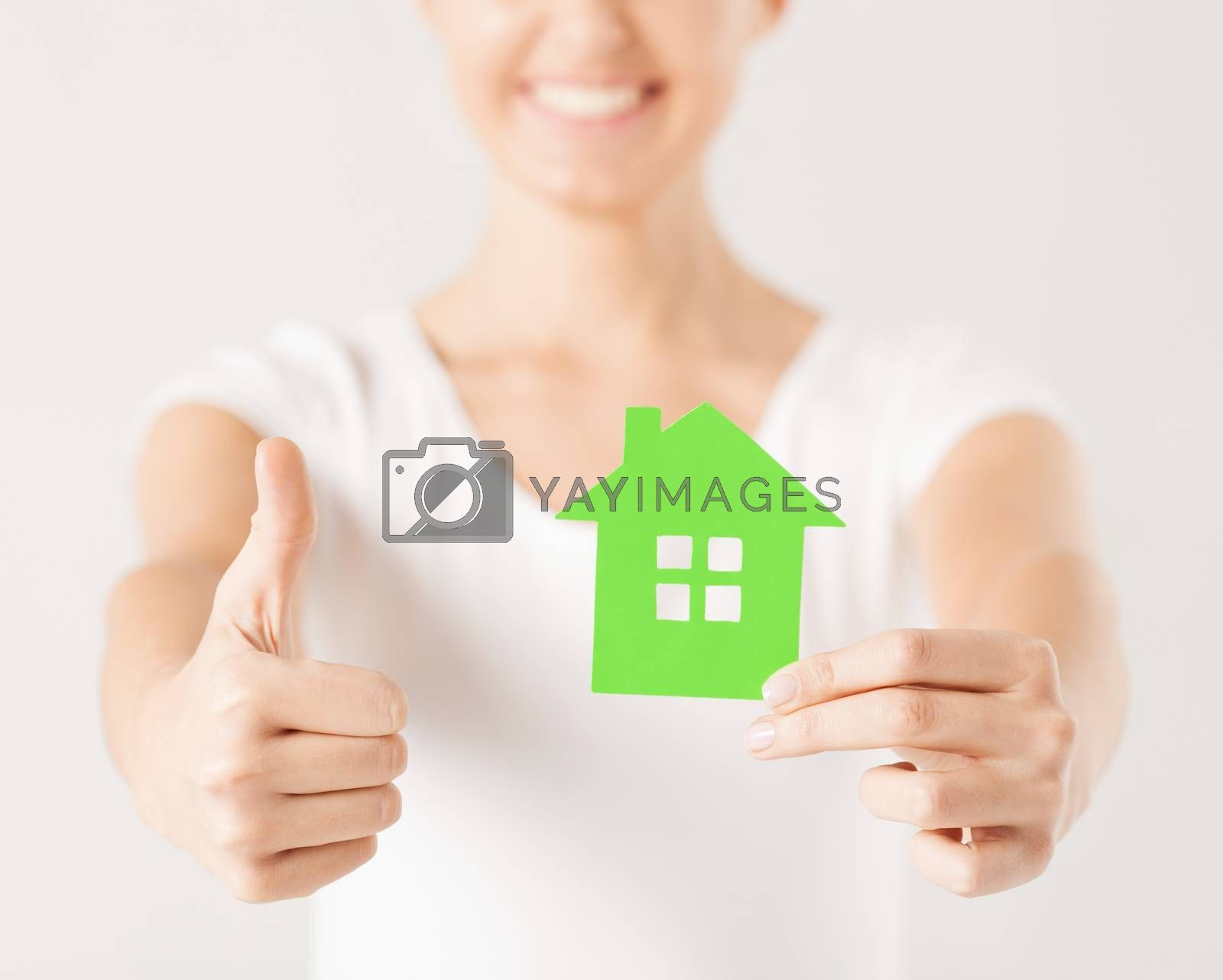 woman hands holding green house by dolgachov