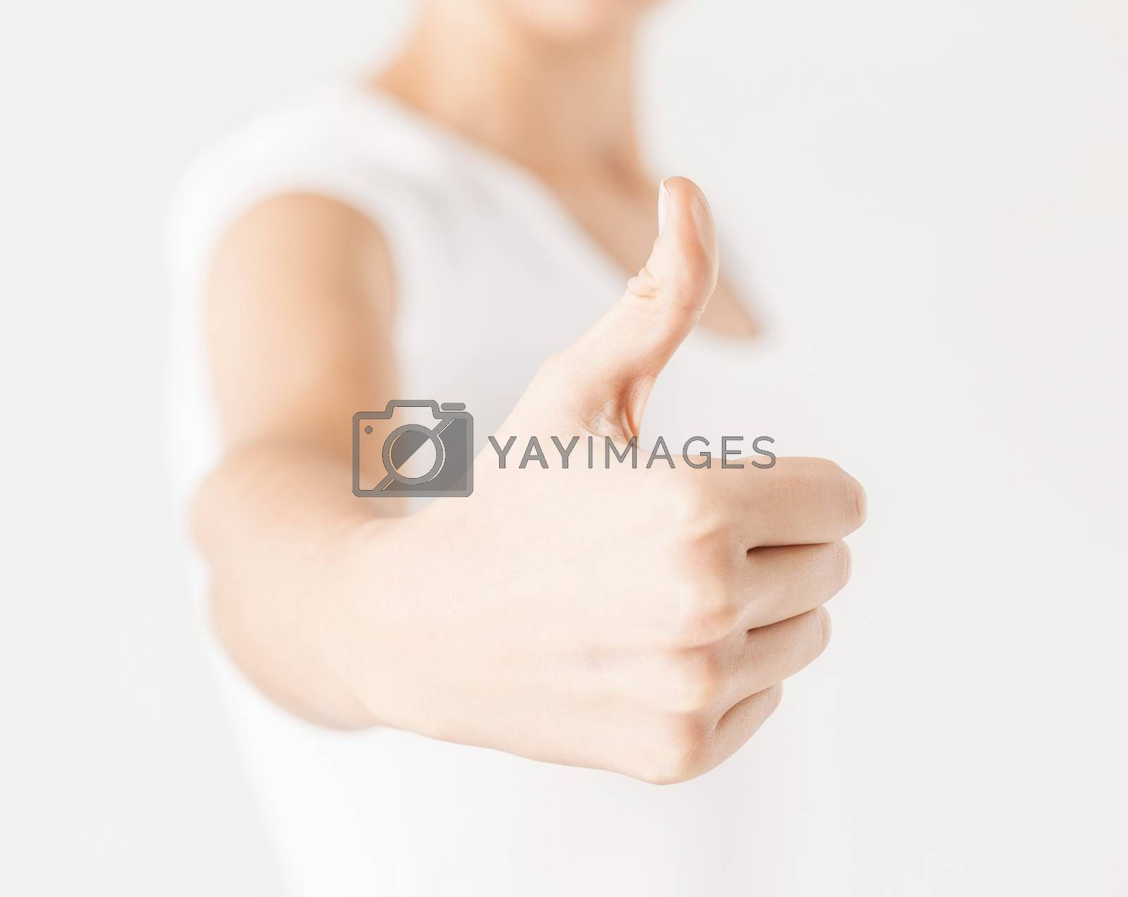 woman showing thumbs up by dolgachov