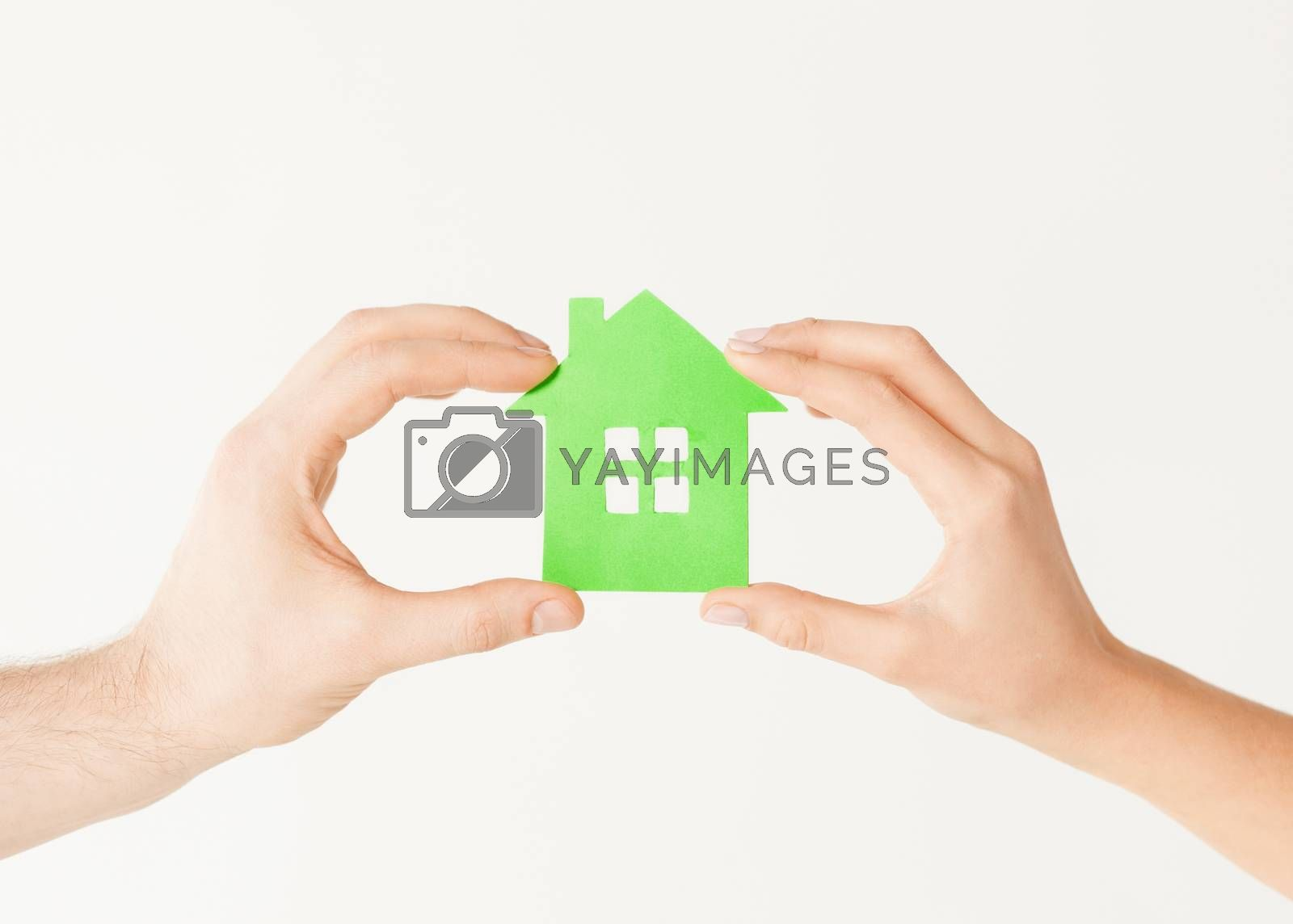 couple hands holding green house by dolgachov