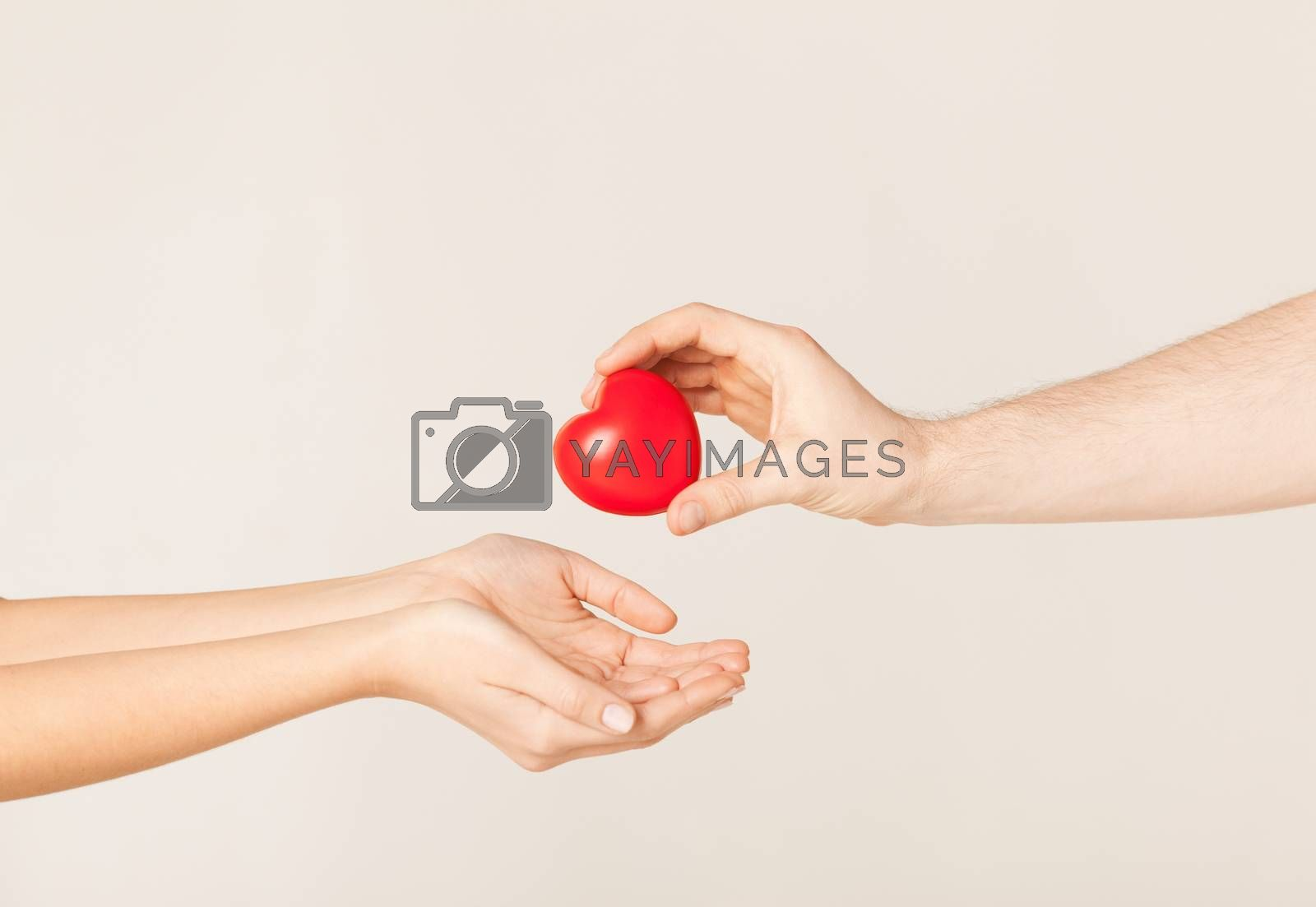 woman and man hands with heart by dolgachov