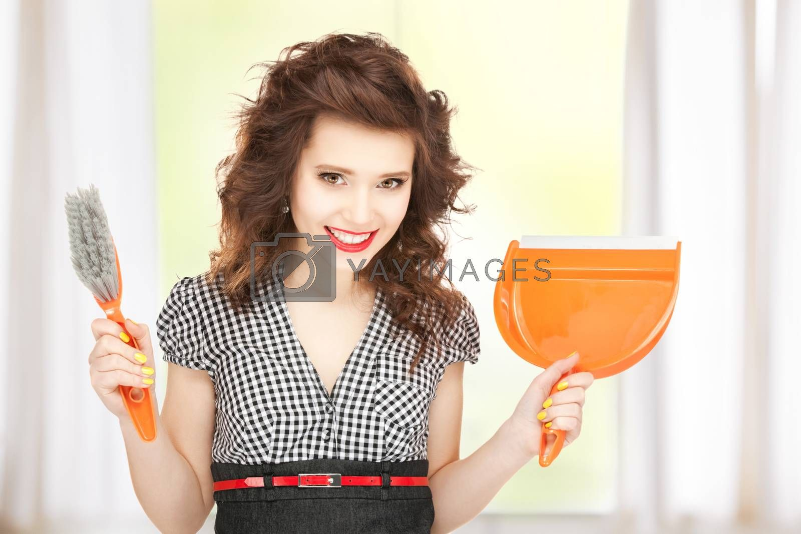 beautiful woman with cleaning sweep by dolgachov