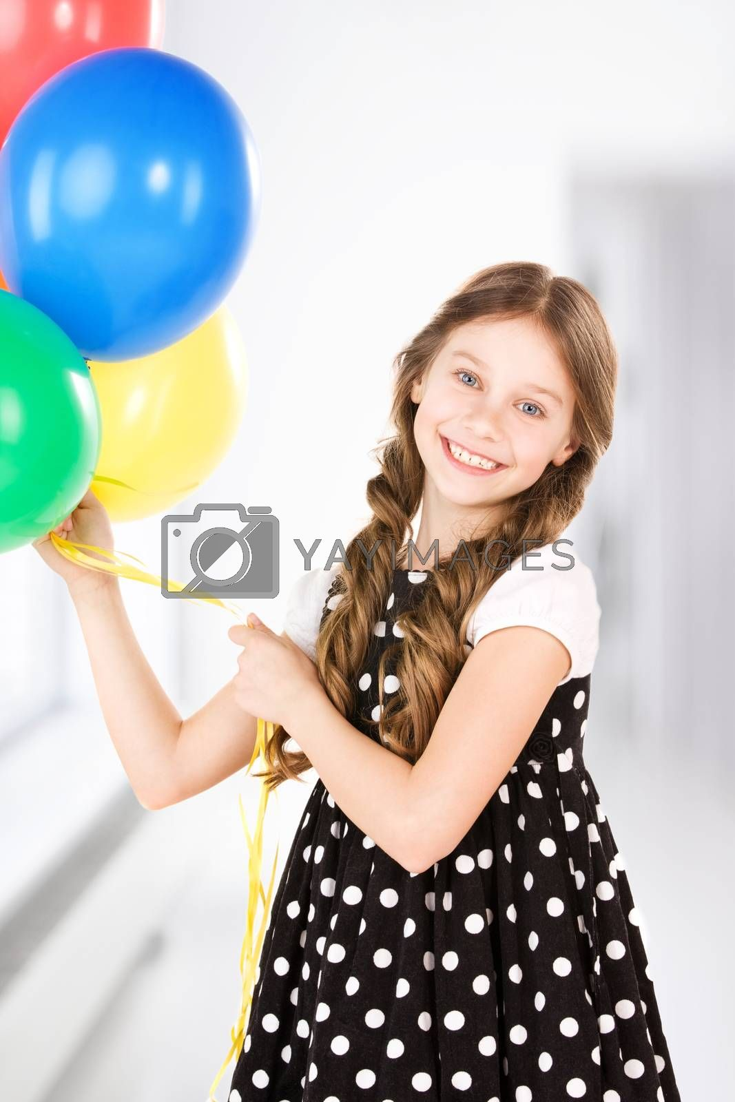 happy girl with colorful balloons by dolgachov