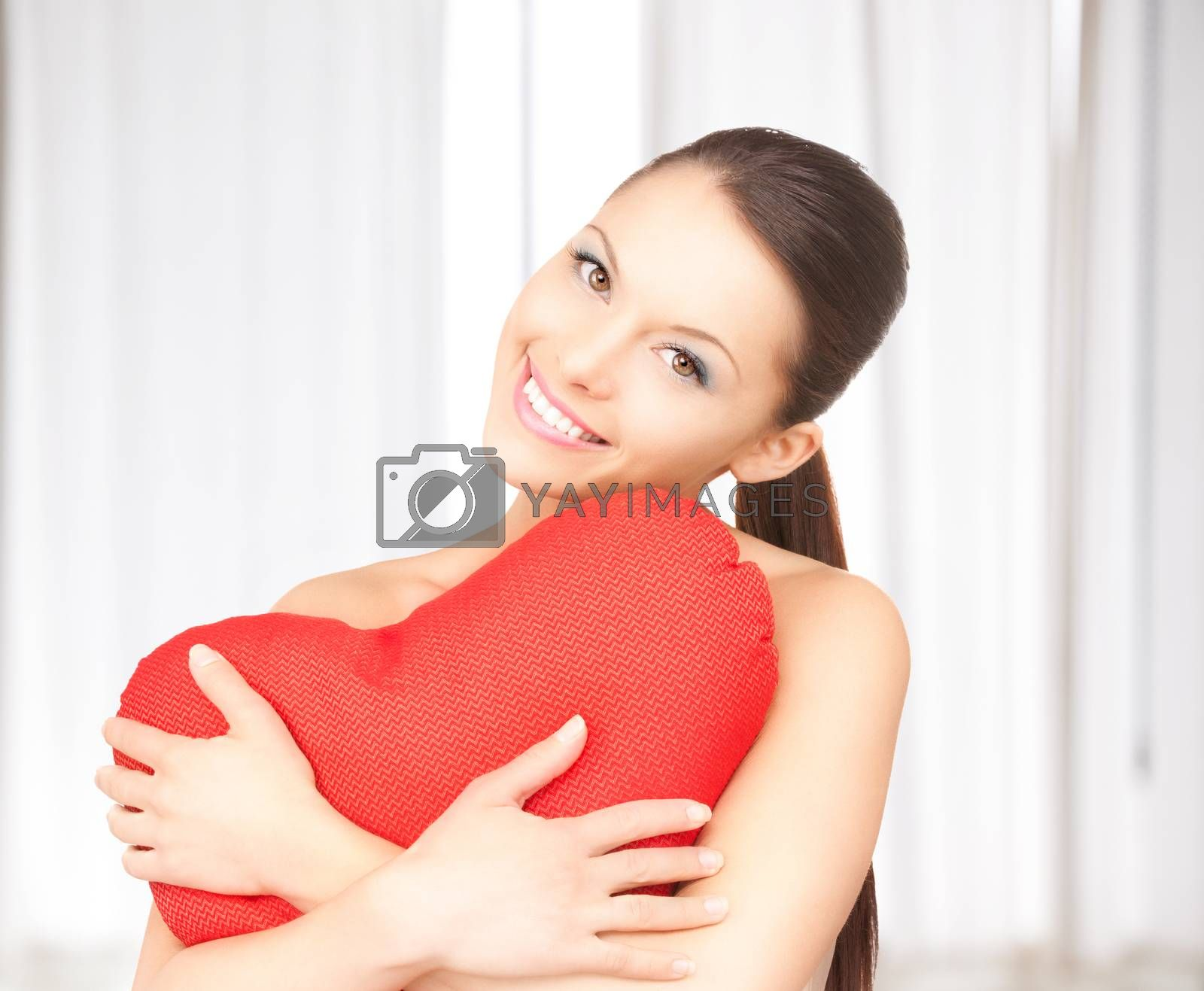 woman with red heart-shaped pillow by dolgachov
