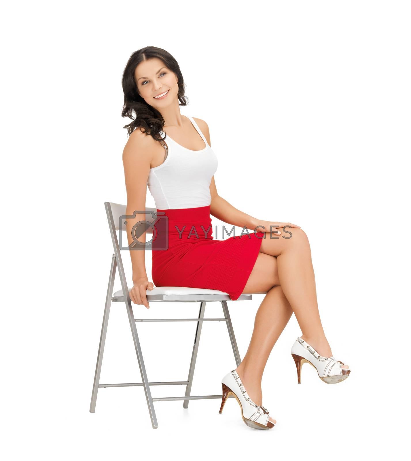 woman sitting on chair by dolgachov