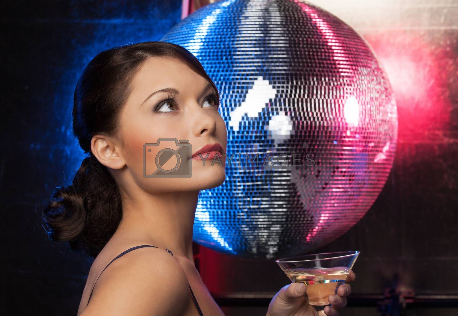 woman with cocktail and disco ball by dolgachov