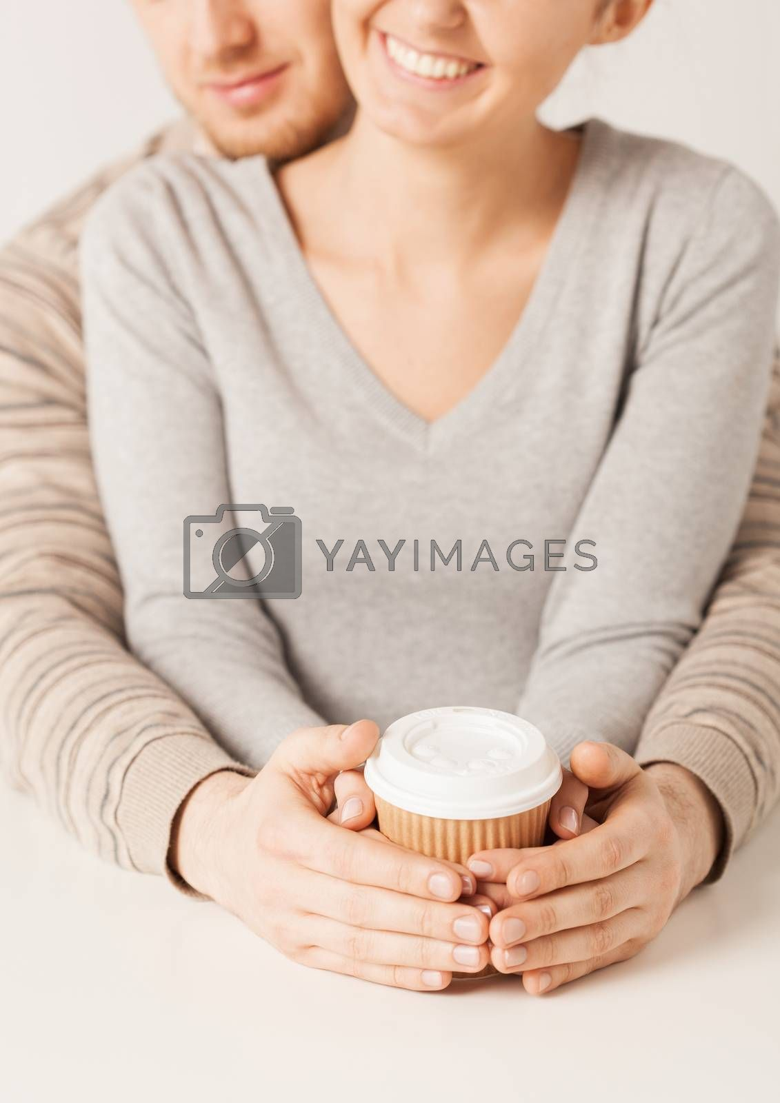 woman and man with take away coffee cup by dolgachov