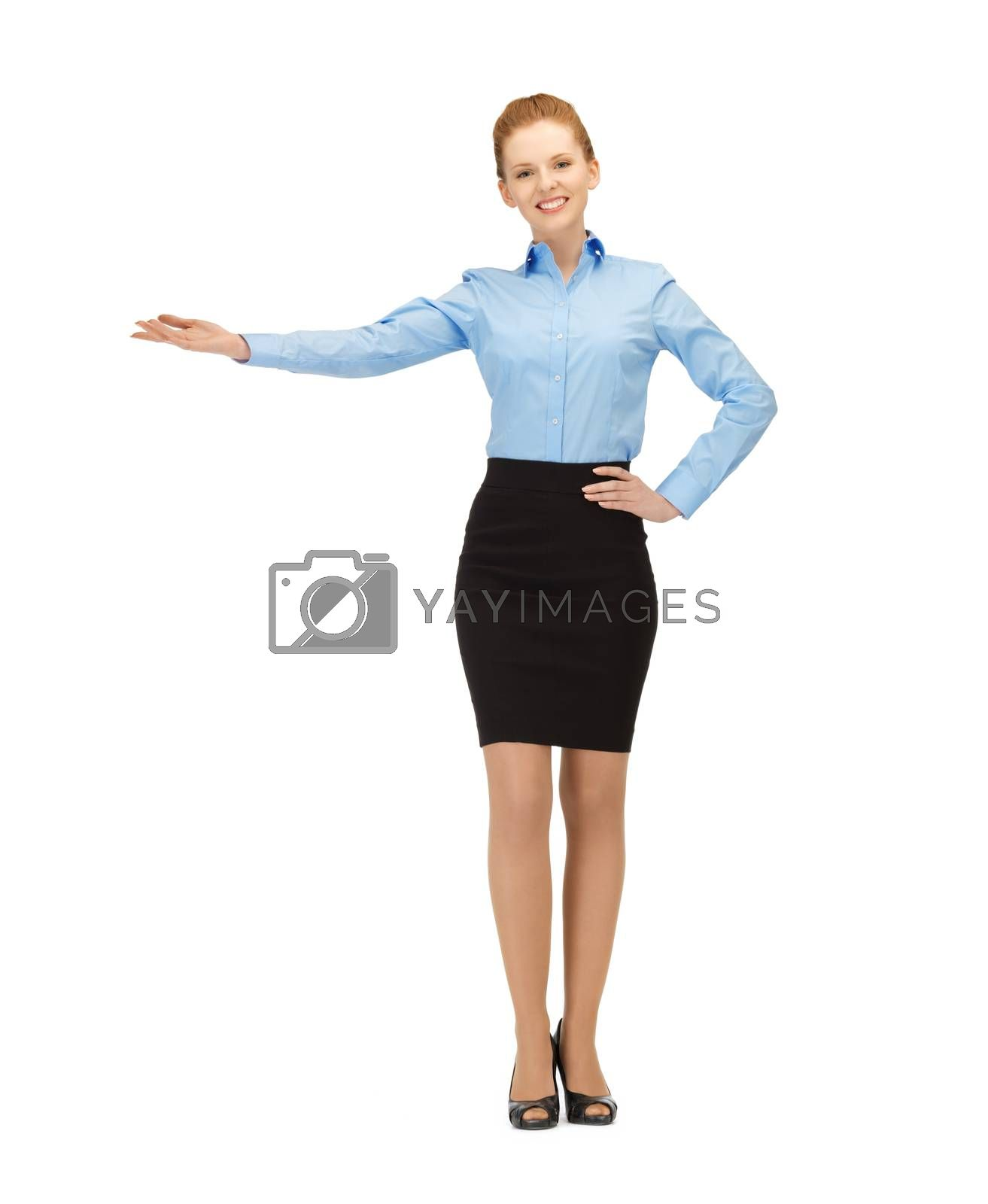 businesswoman showing something with her hand by dolgachov