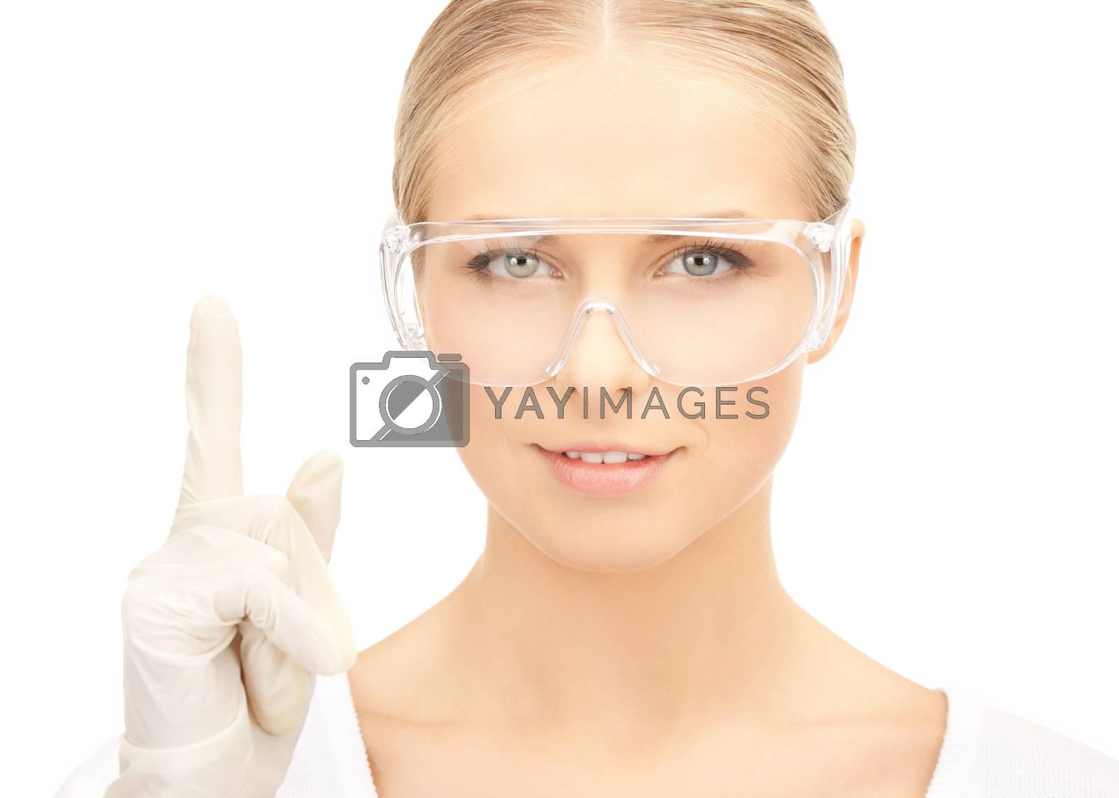 scientist in eyeglasses holding finger up by dolgachov