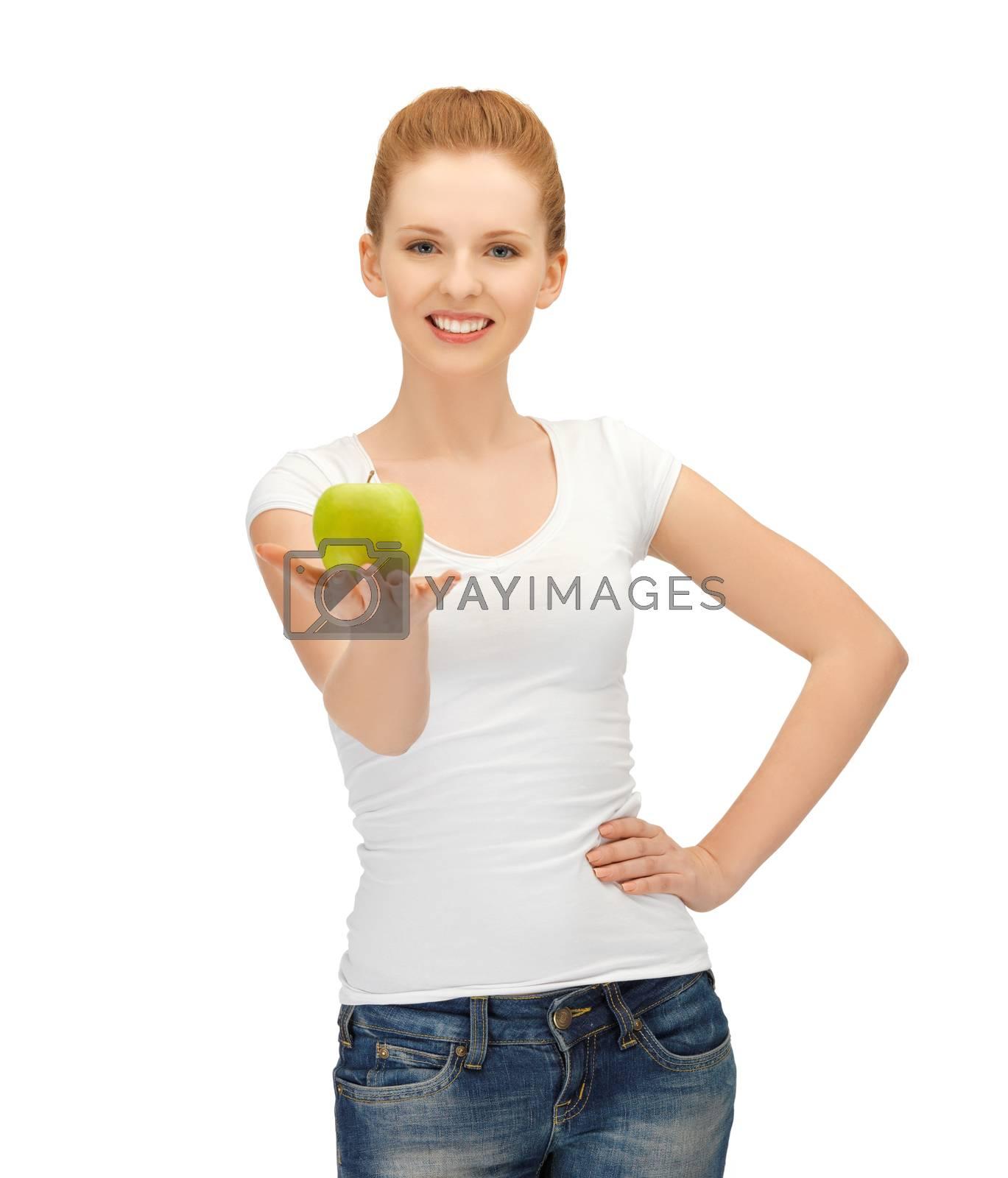 woman in blank t-shirt eating green apple by dolgachov