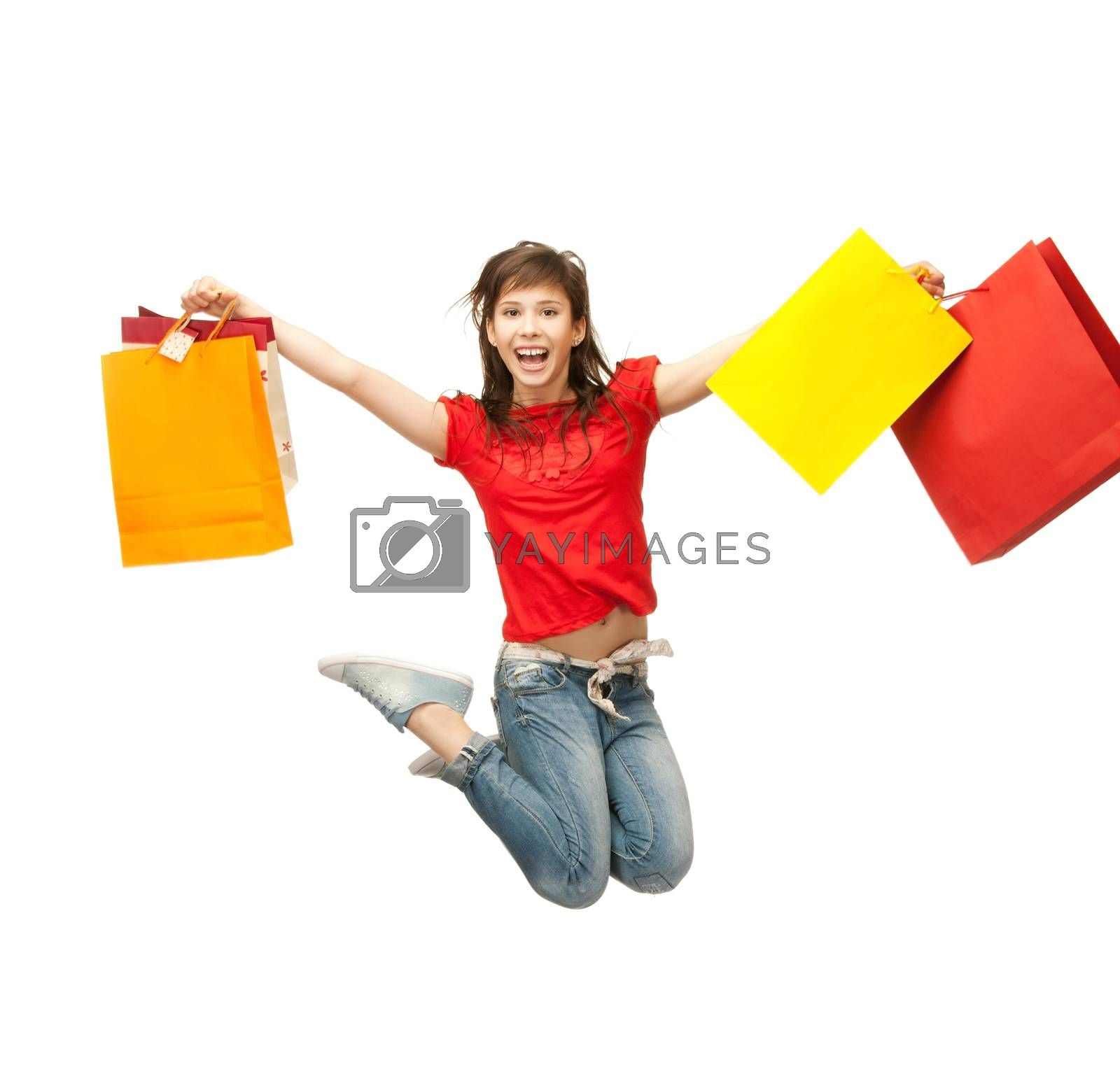 excited girl with shopping bags by dolgachov