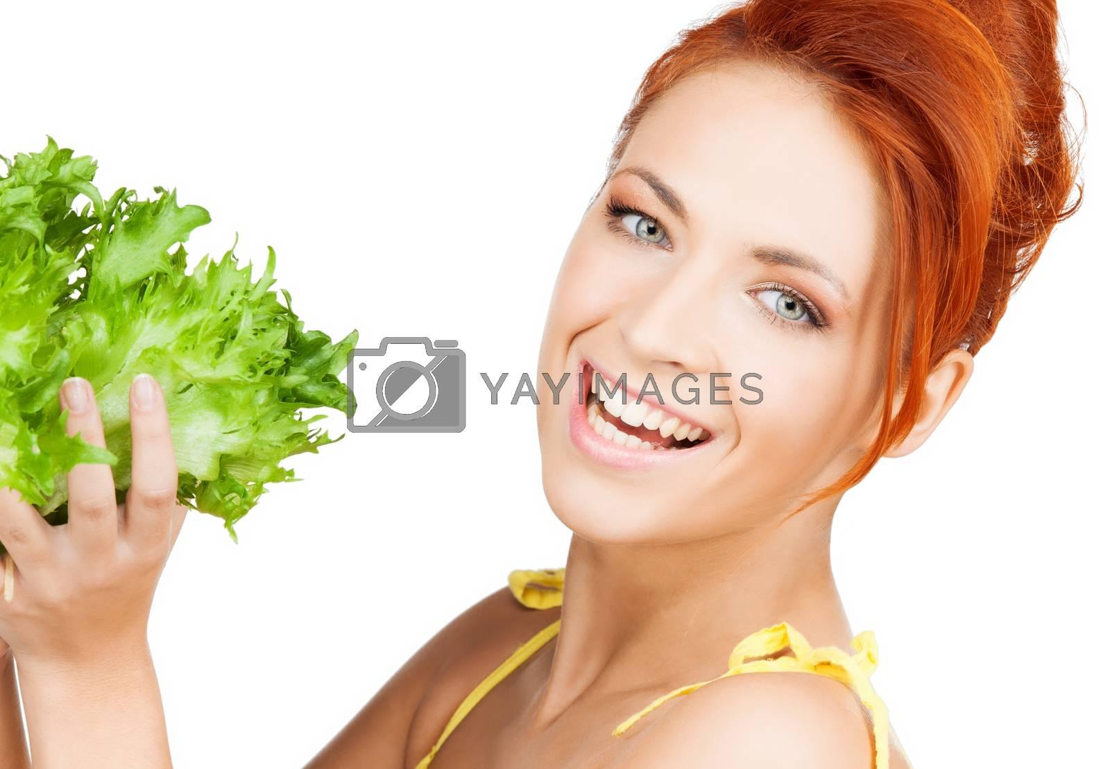 woman holding lettuce by dolgachov