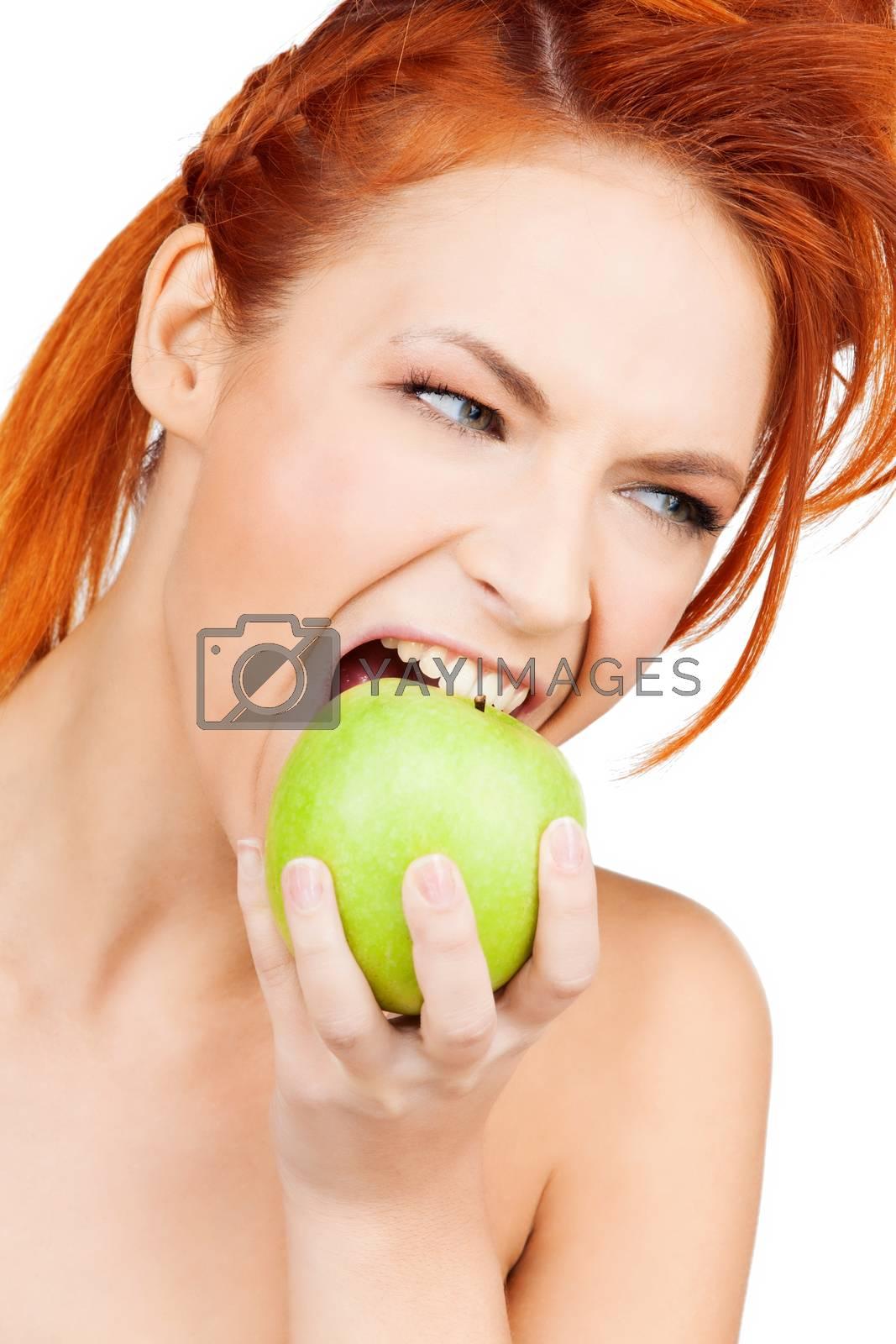 woman biting green apple by dolgachov