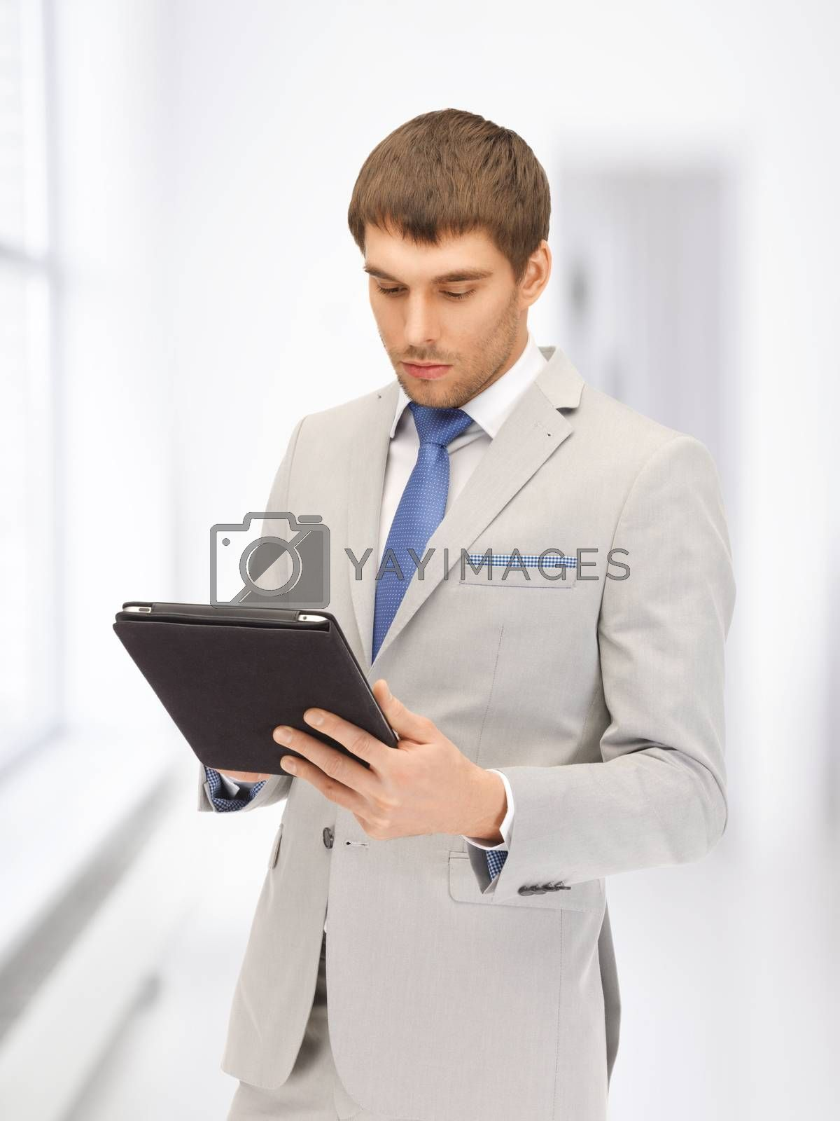 calm man with tablet pc computer by dolgachov
