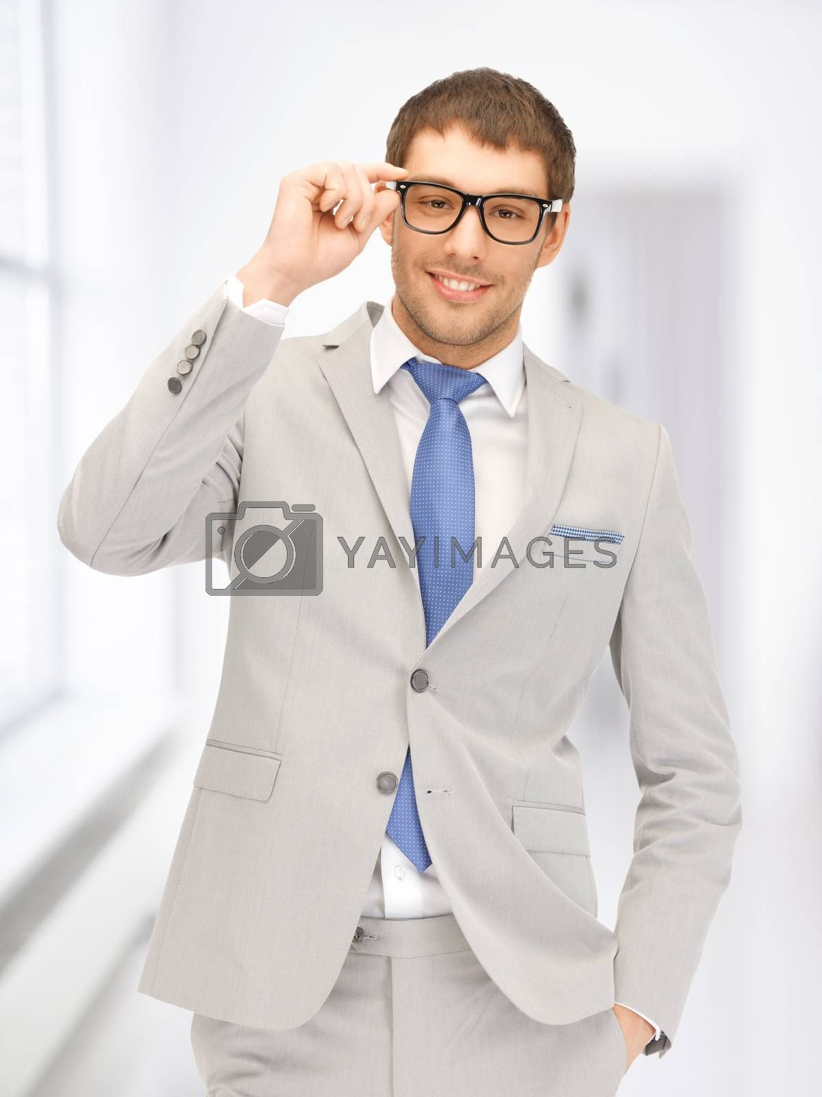 happy businessman in spectacles by dolgachov