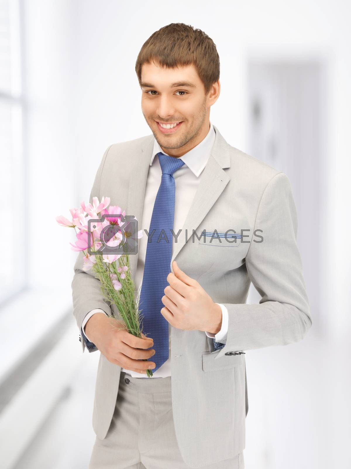 handsome man with flowers in hand by dolgachov