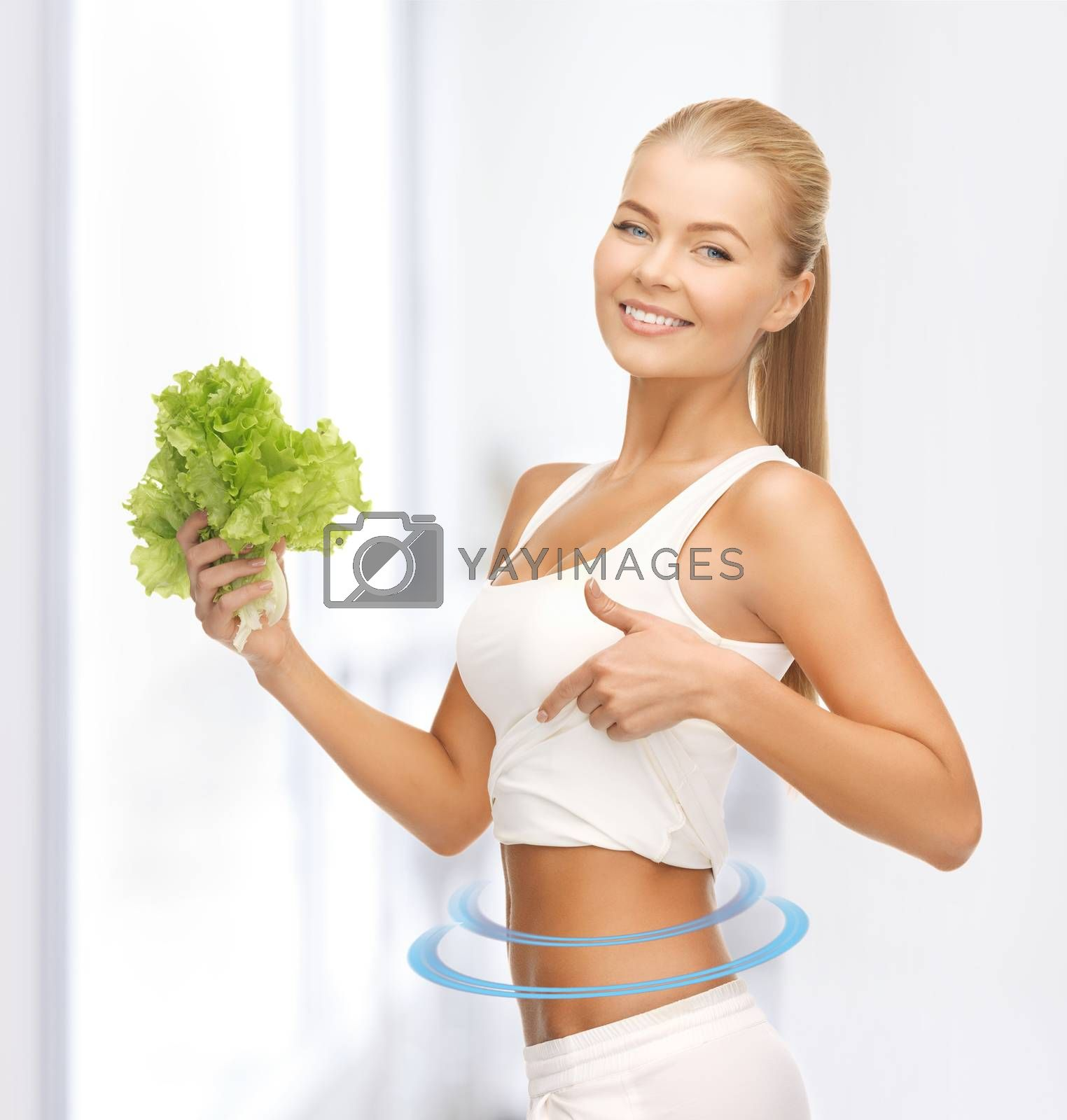 sporty woman with lettuce showing abs by dolgachov