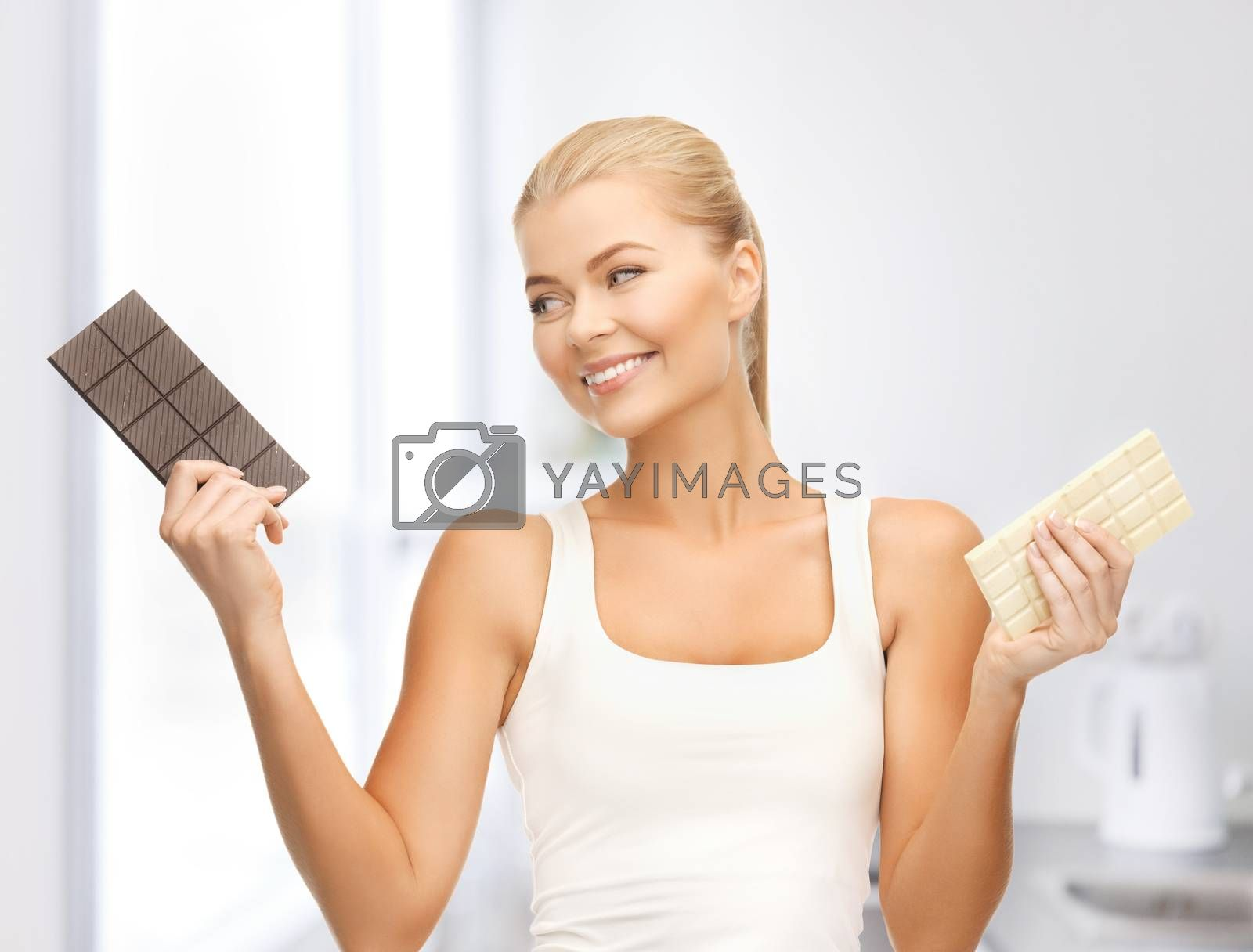 smiling woman with dark and white chocolates by dolgachov