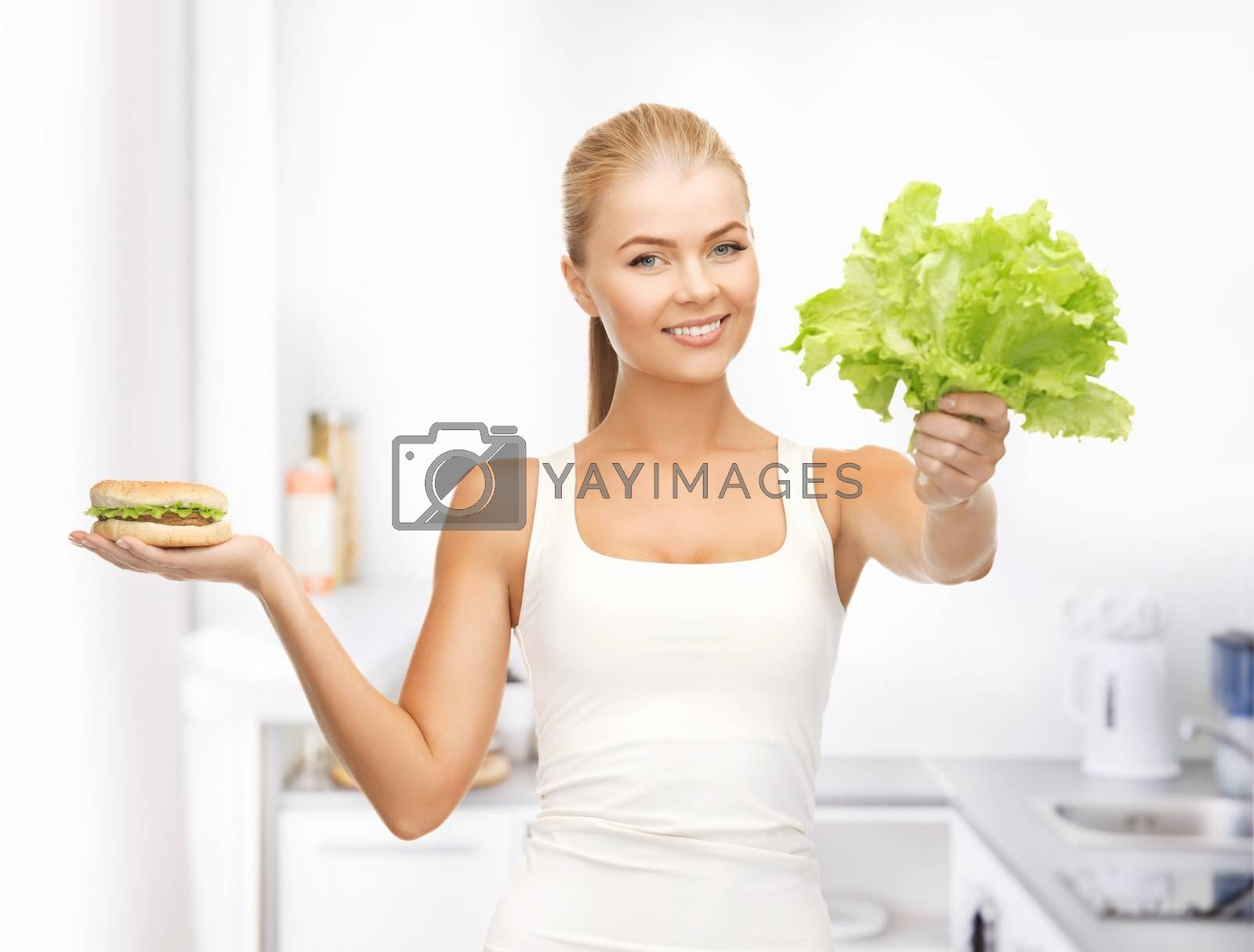woman with green leaves and hamburger by dolgachov
