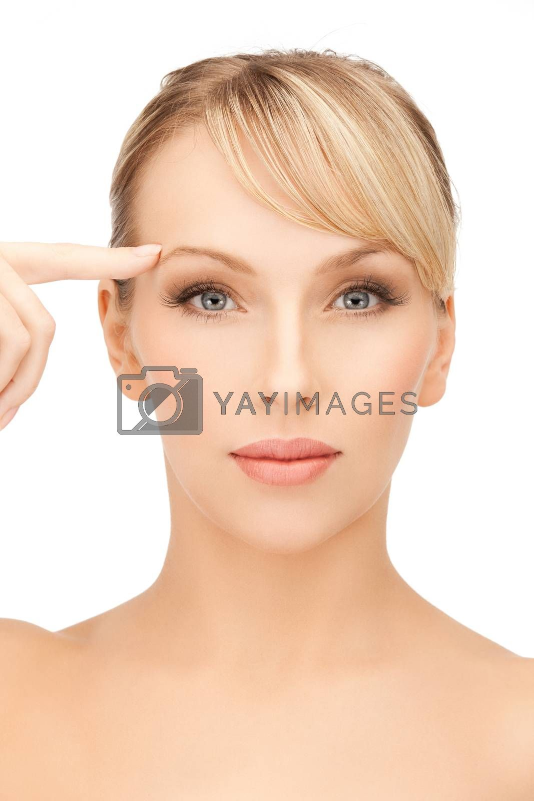 woman touching her face skin by dolgachov