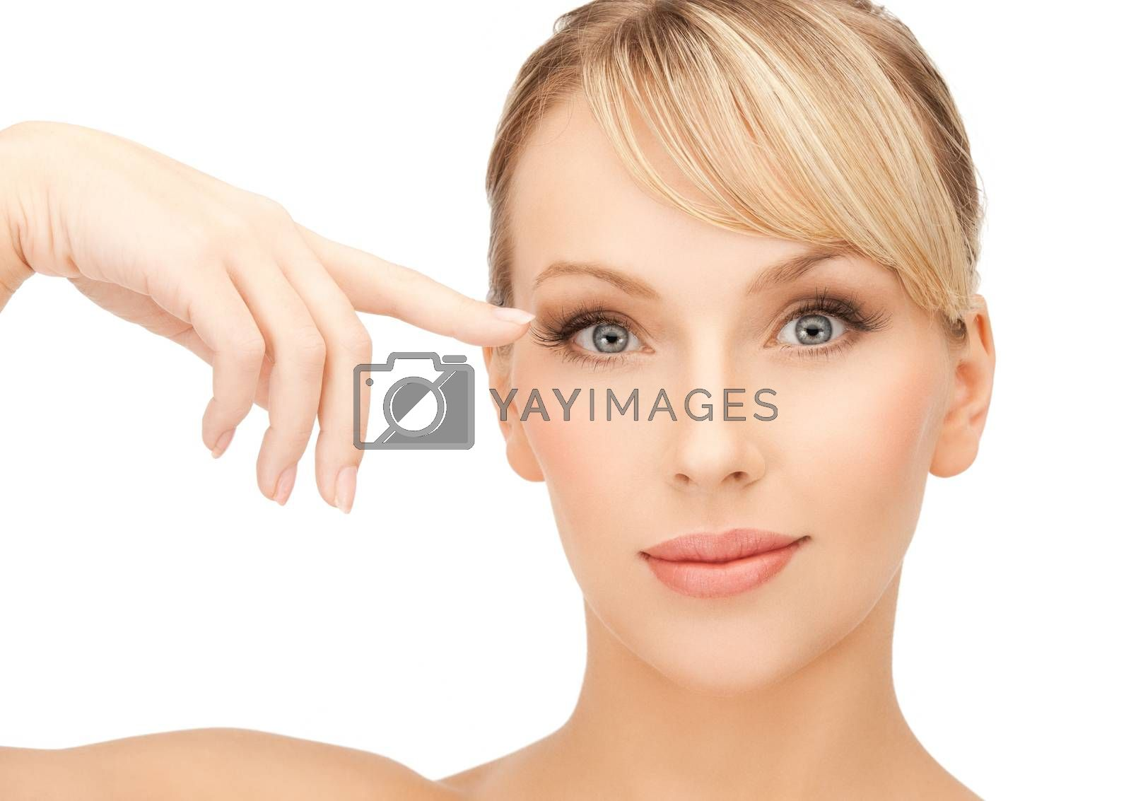 beautiful woman touching her eye area by dolgachov