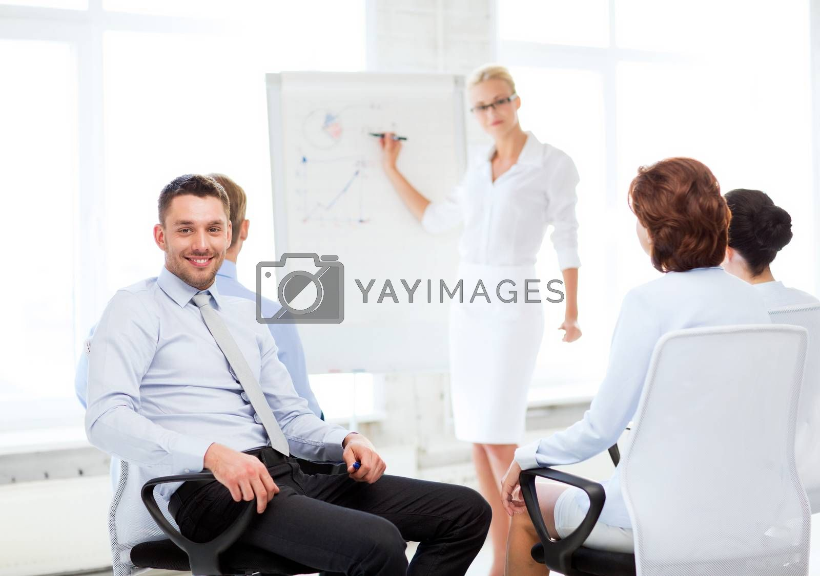 picture of smiling businessman on business meeting in office