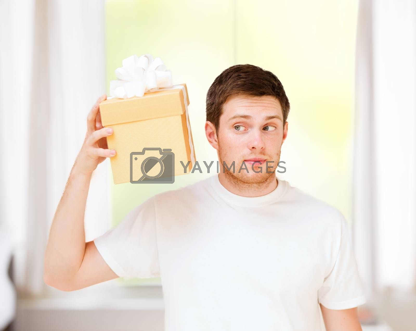 presents, gifts and celebration - man in white t-shirt with gift box