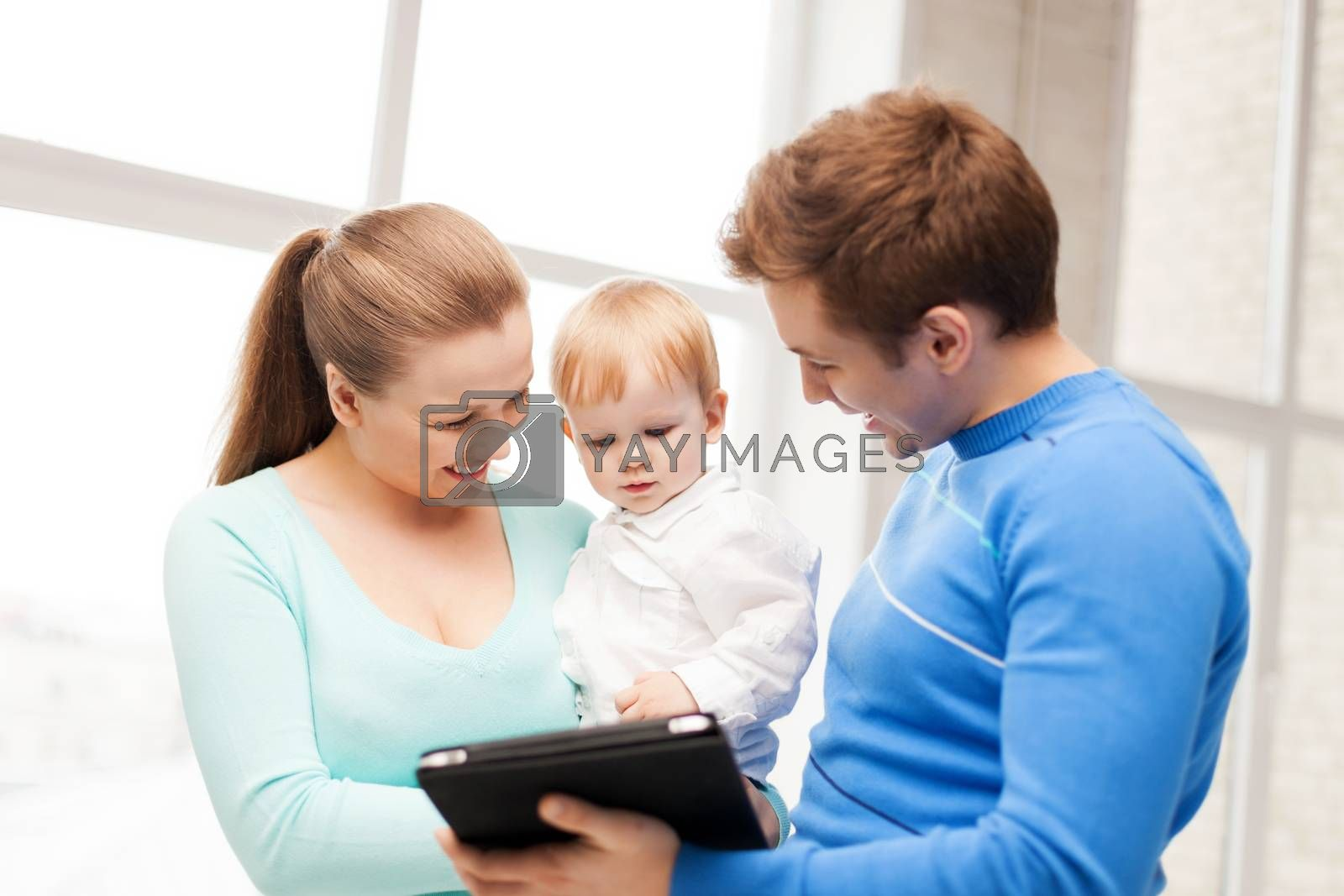 happy parents and adorable baby with tablet pc