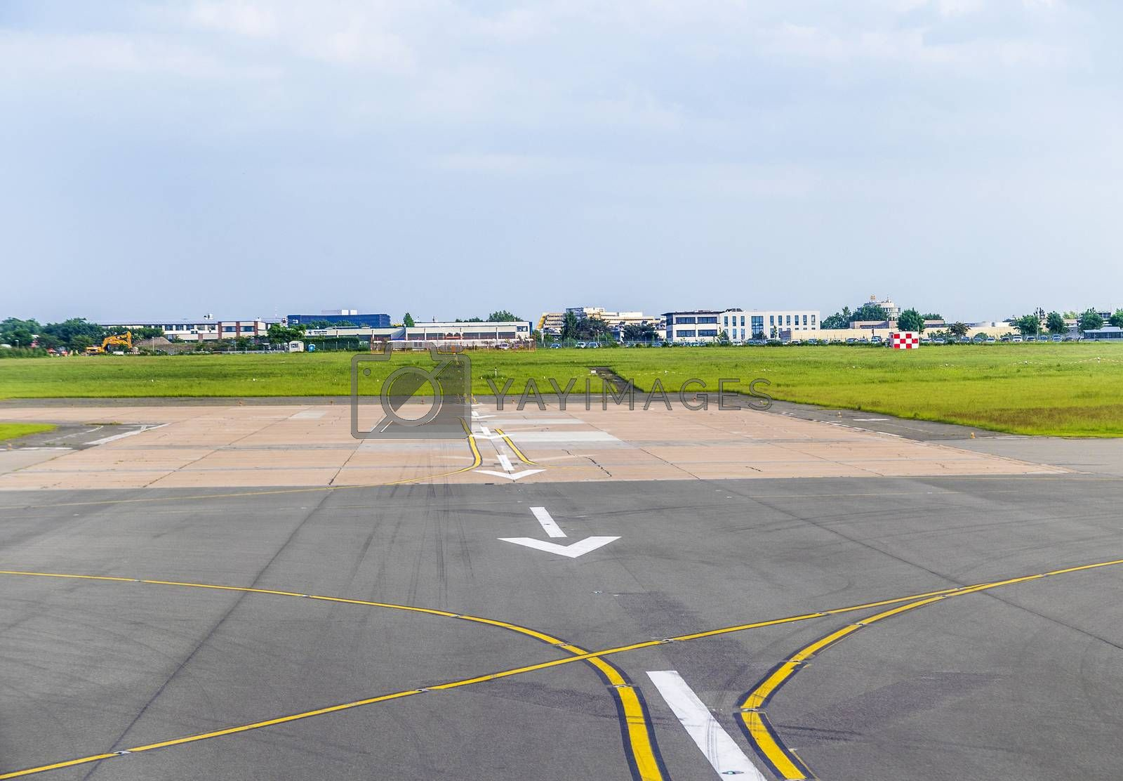 white arrows at airport runway landing zone