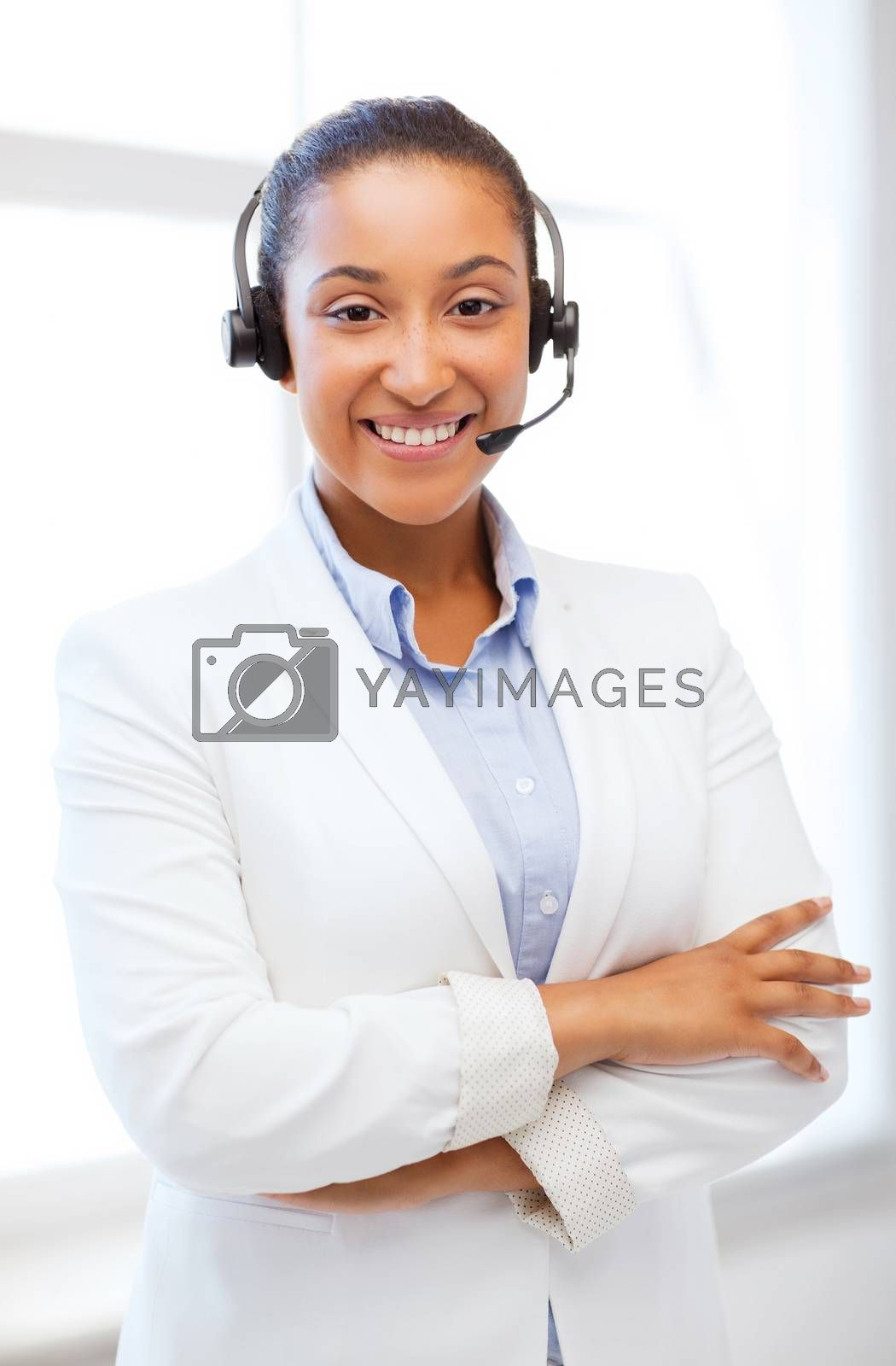 business, communication and call center - african helpline operator with headphones