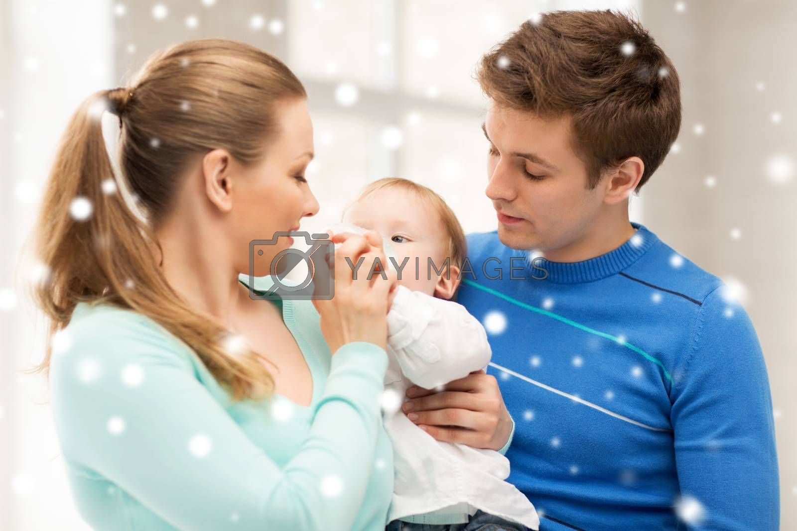 children, christmas, x-mas, love concept - happy family and adorable baby with feeding-bottle