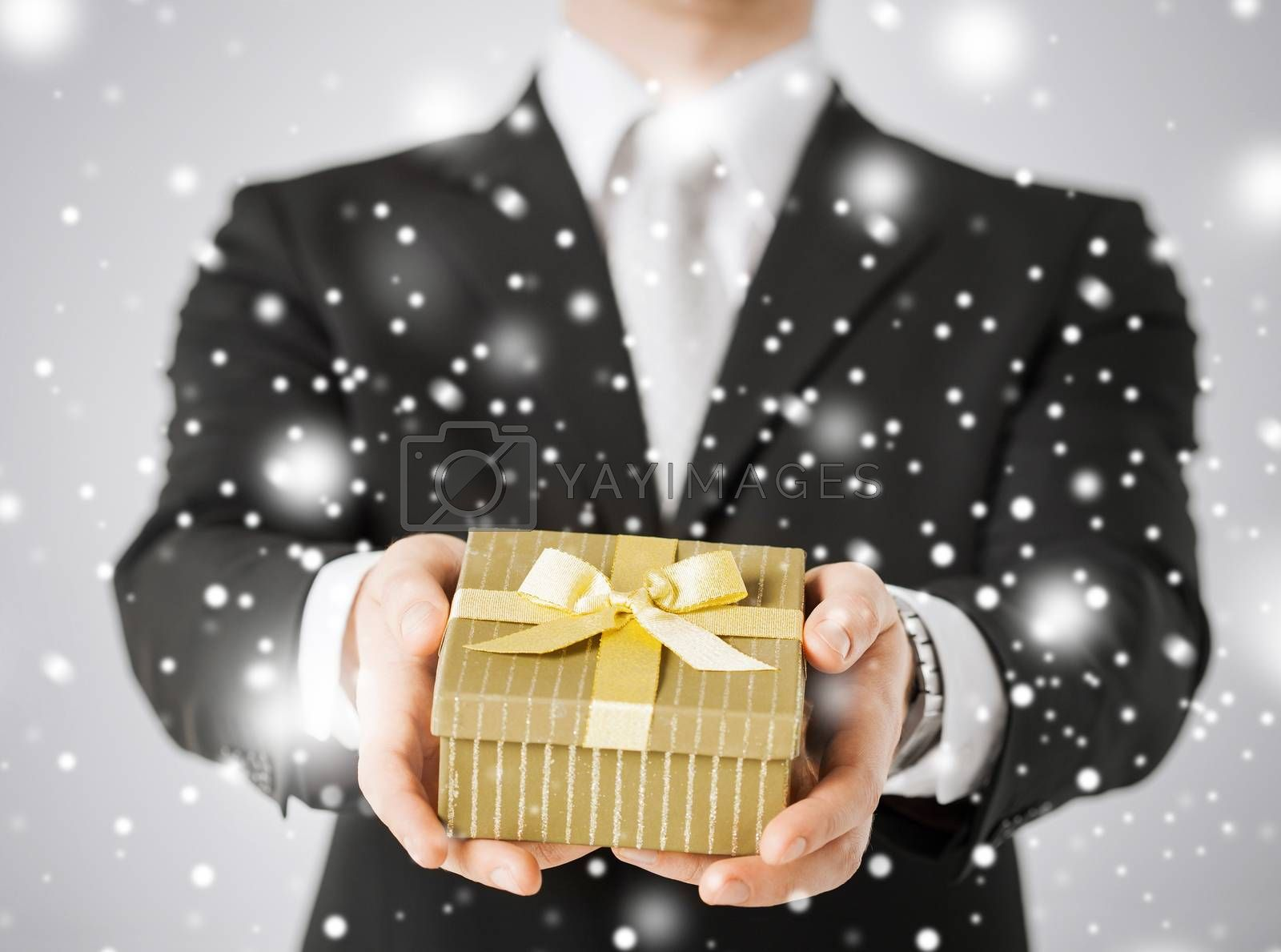 love, romance, holiday, celebration concept - man giving gift box