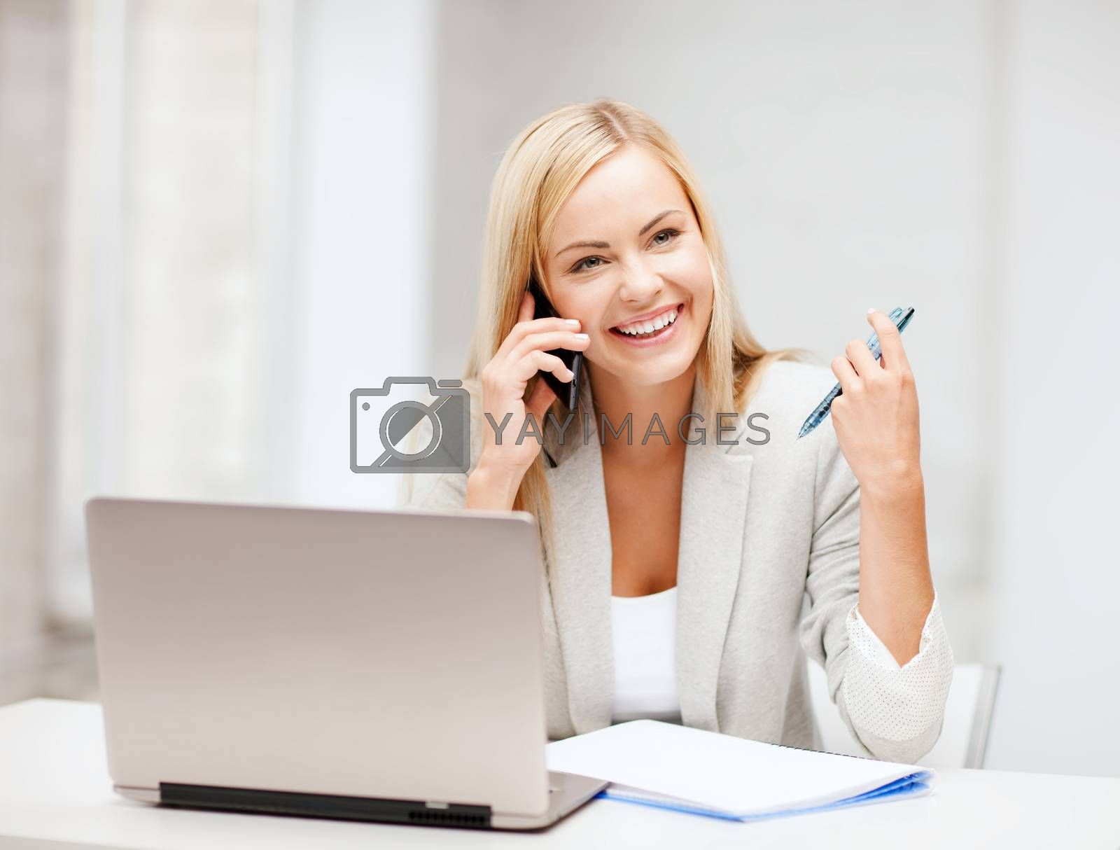 business and communication - smiling businesswoman with smartphone in office