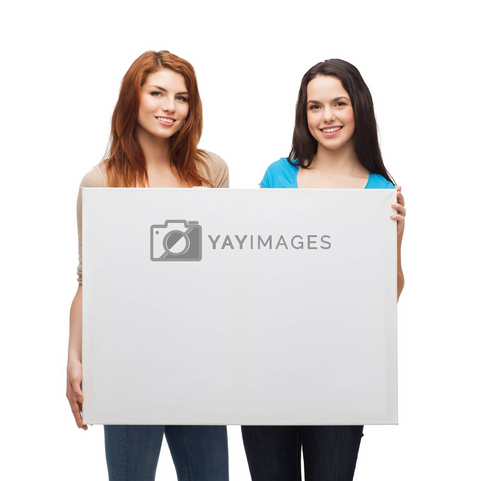 advertisement, sale and people concept - smiling young girls with blank white board