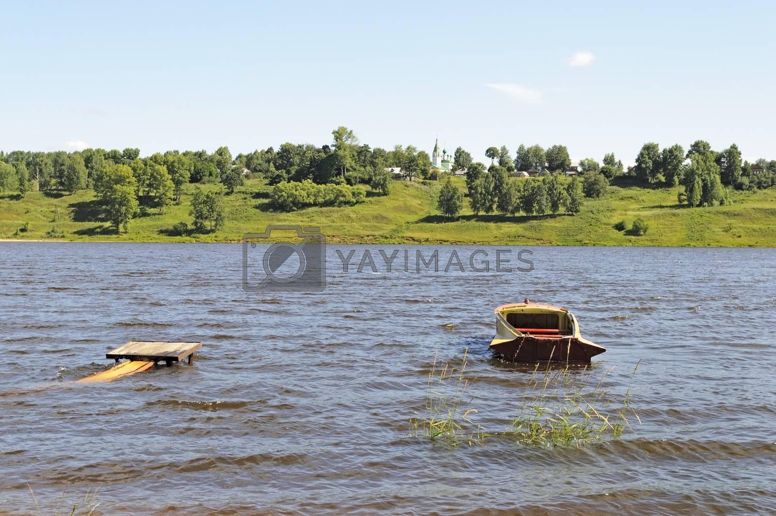 Boat near the bank of the Volga river in Tutaev, Russia